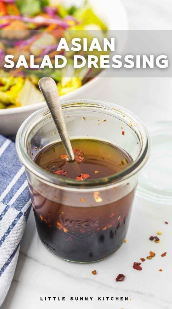 Salad dressing in a mason jar with a spoon