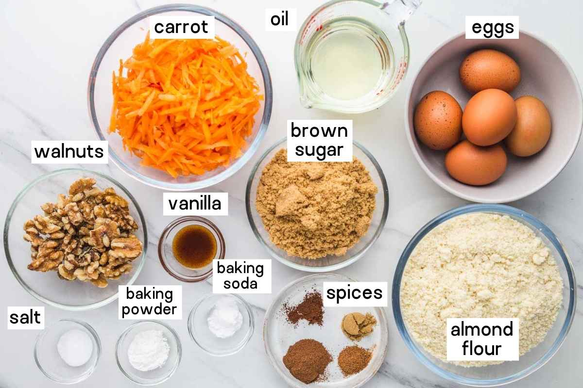 Ingredients needed for the carrot cake: almond flour, eggs, carrot, oil, brown sugar, spices, vanilla, walnuts, baking powder, baking soda, and salt.