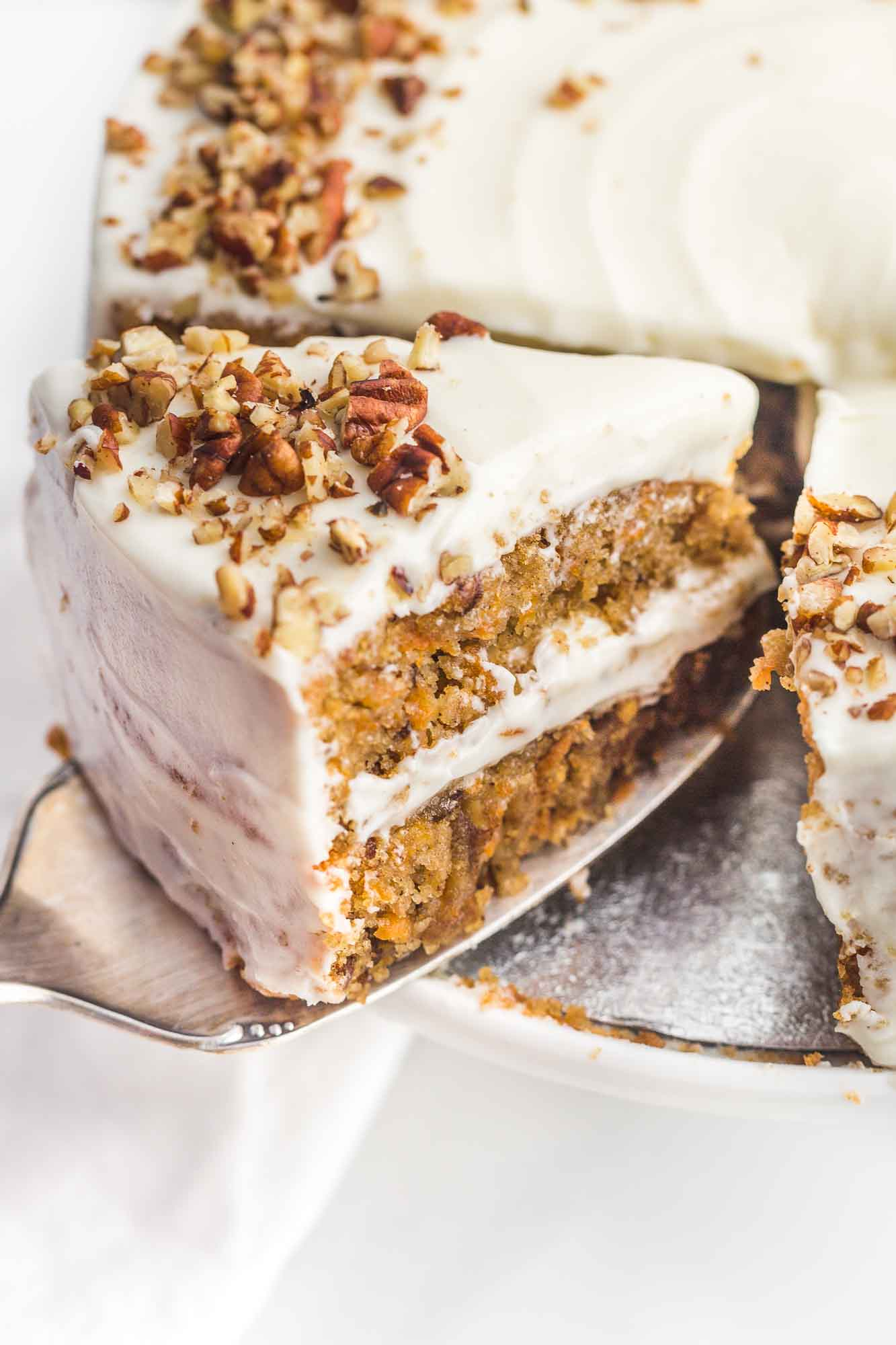 Side view of the gluten free carrot cake slice with a server.