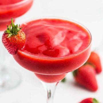 Strawberry Daiquiri in martini glasses, garnished with fresh strawberries