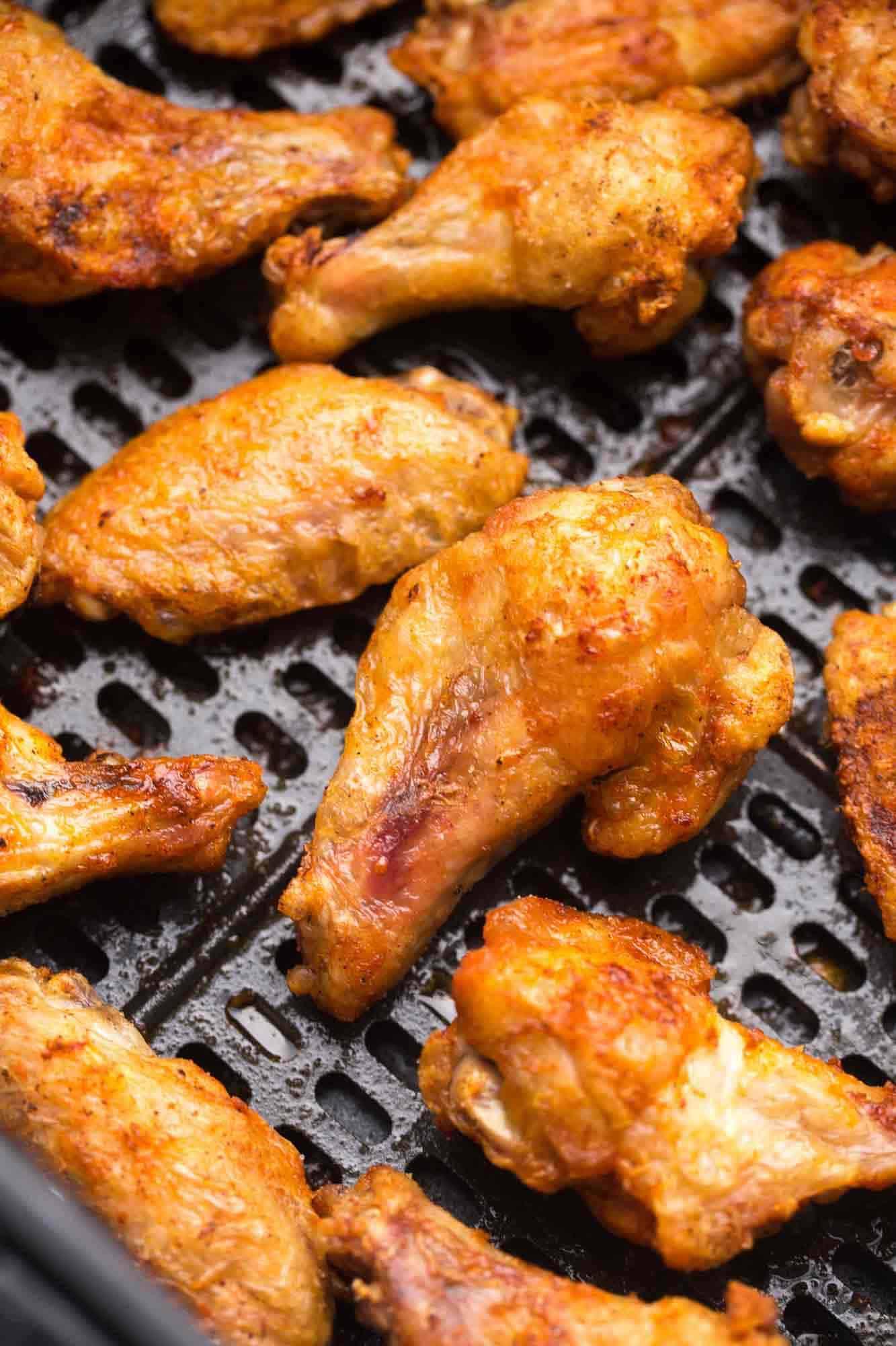Air Fried chicken wings in a Cosori air fryer basket