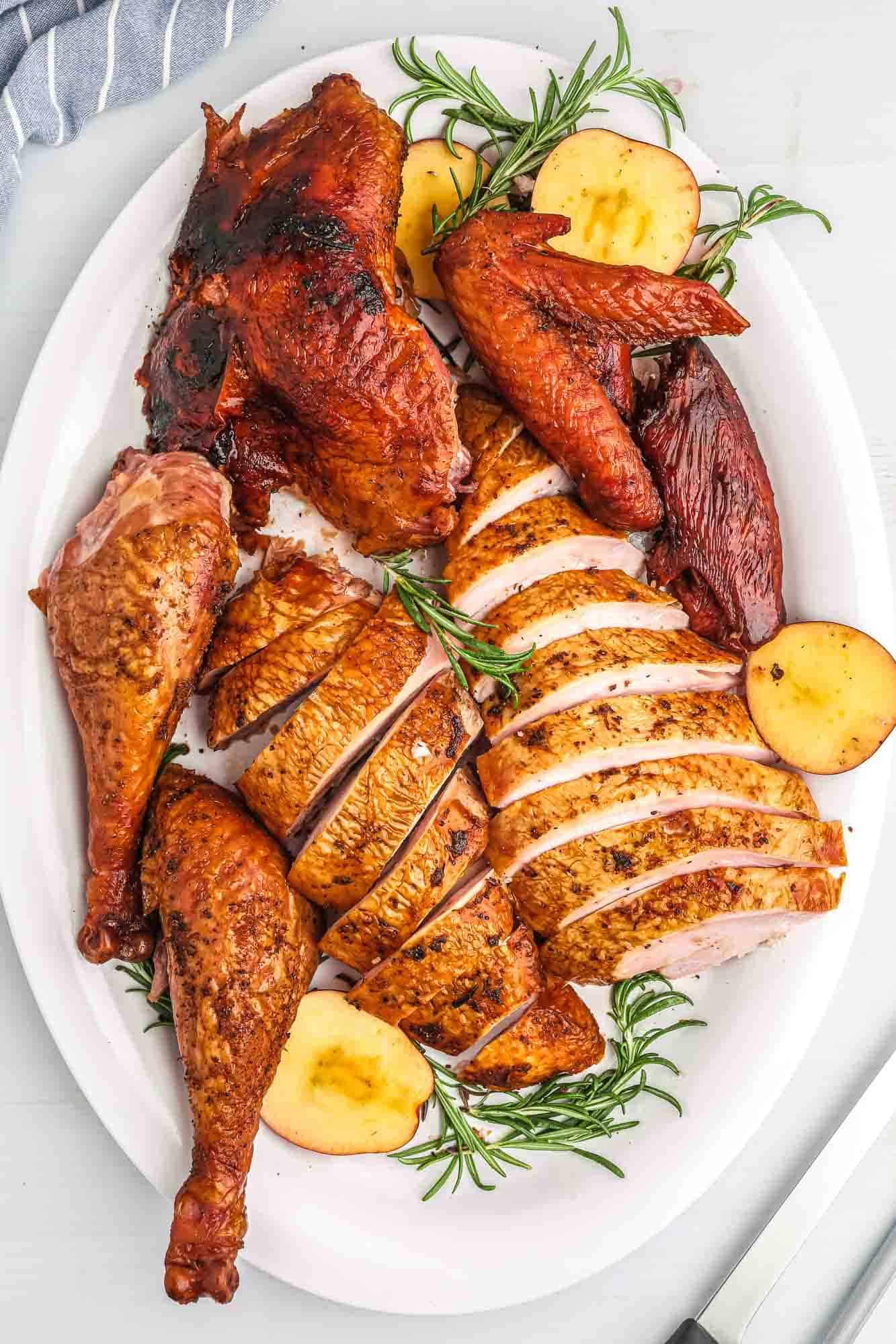 Carved turkey served on a white platter