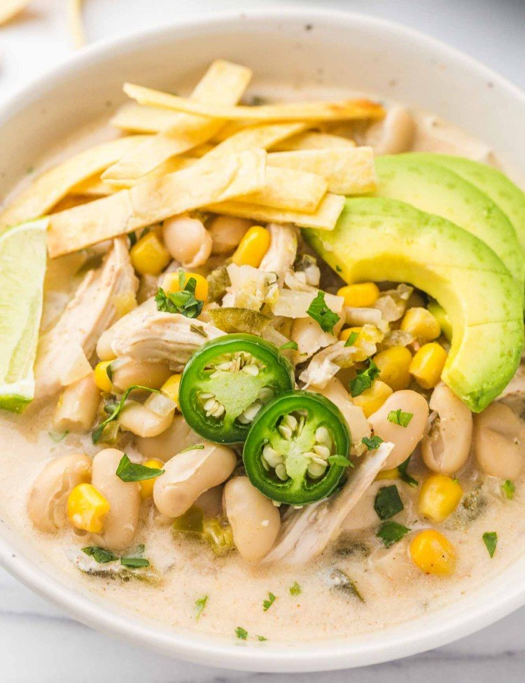 Crockpot White Chicken Chili served in a white bowl with toppings