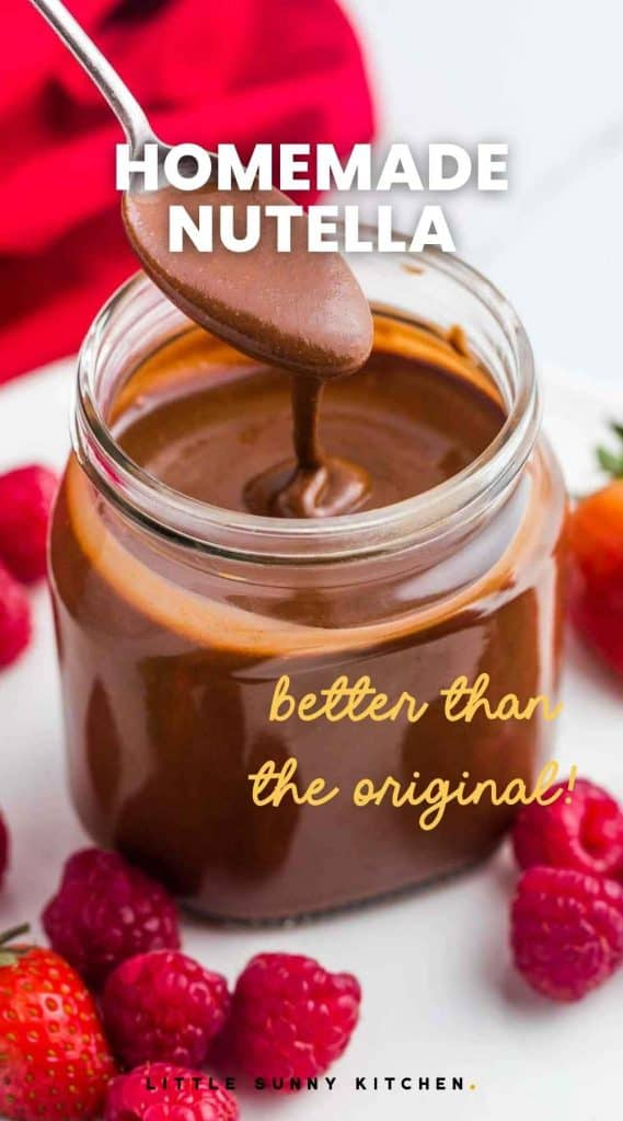 """Homemade nutella in a jar with a spoon, and fresh berries. With overlay text """"Homemade nutella, better than the original)"""