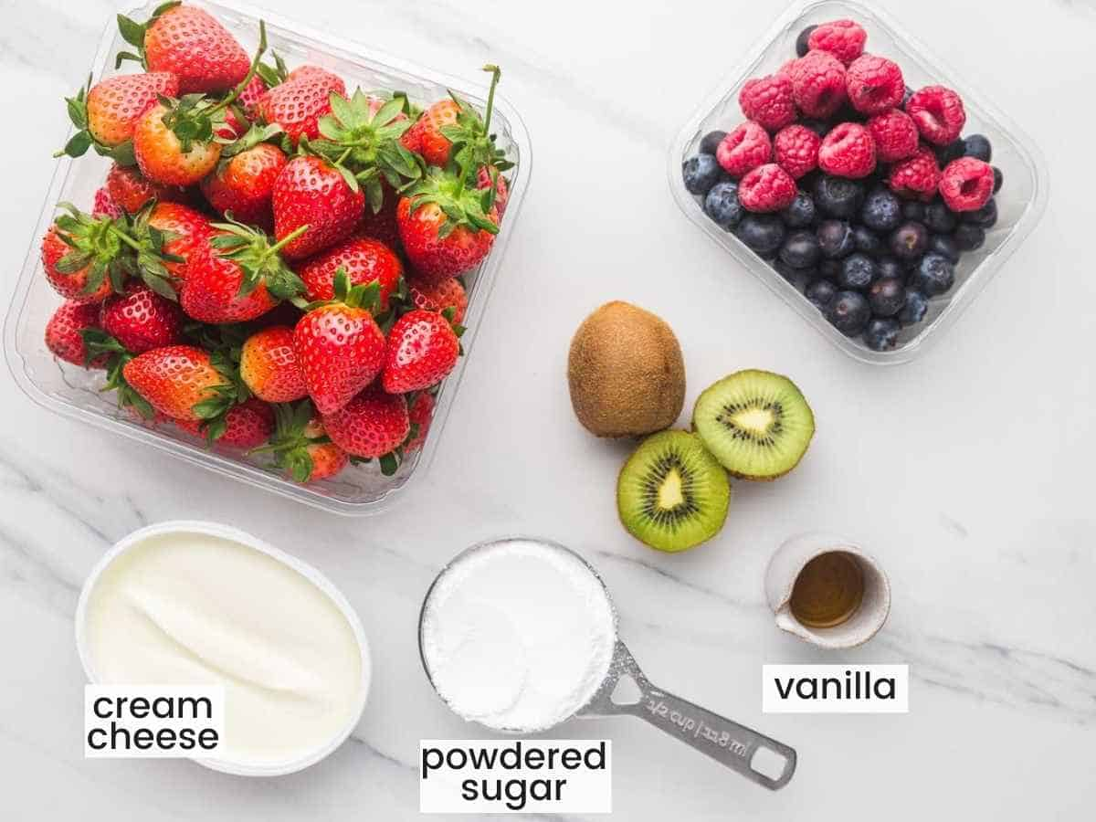 Ingredients needed for the topping including cream cheese, powdered sugar, vanilla, and fruit.