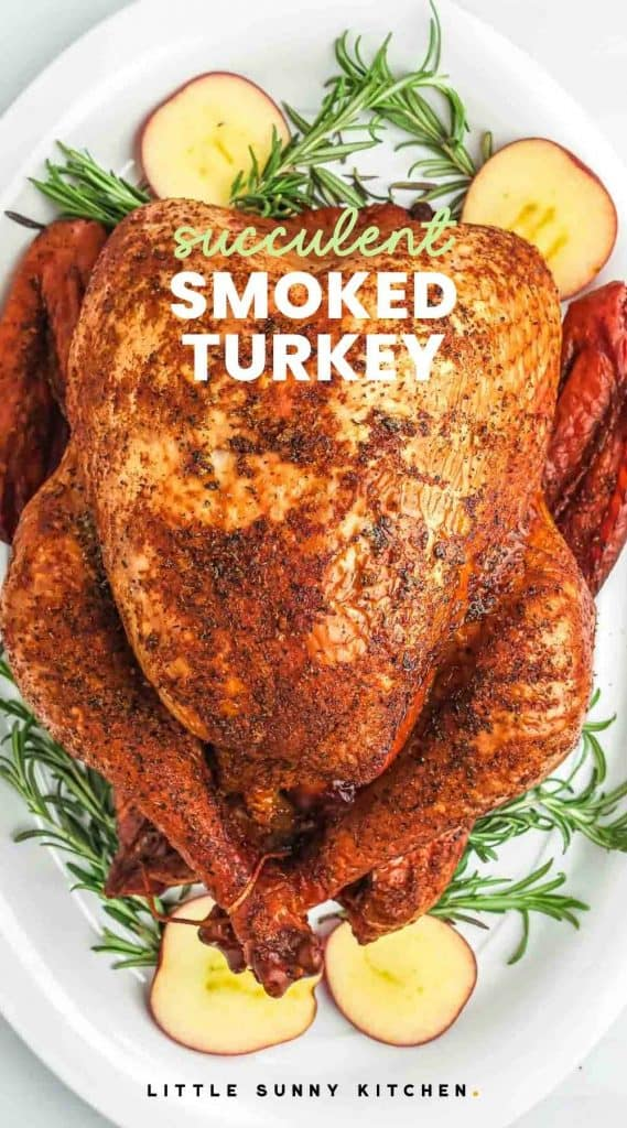 """Smoked Turkey served on a platter with apple slices and herbs, with overlay text """"Succulent smoked turkey"""""""