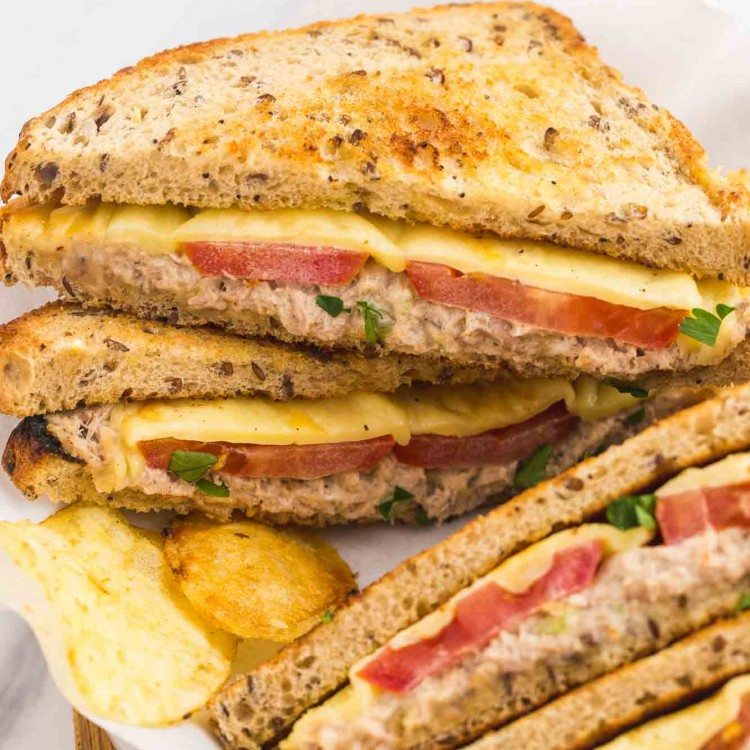 Stacked tuna melt sandwiches with potato chips