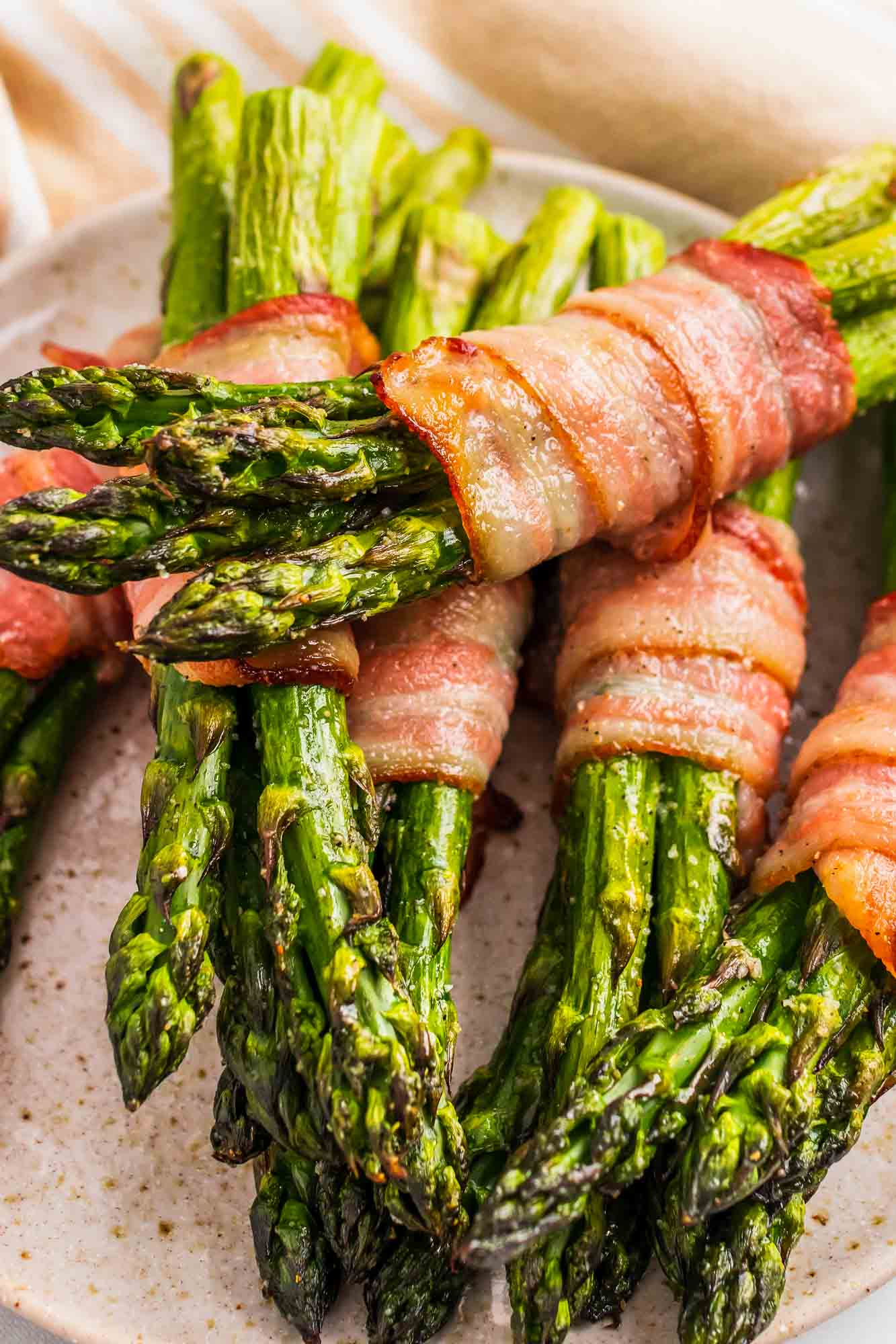 Bacon Wrapped Asparagus stacked on a plate