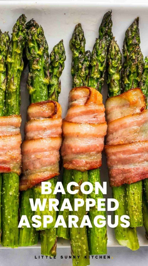 """Bacon Wrapped Asparagus on a plate with overlay text """"Bacon Wrapped Asparagus"""""""