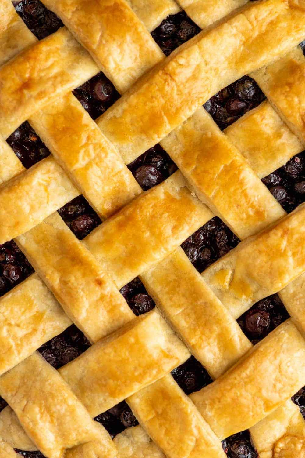 Close up shot of lattice top of a baked pie