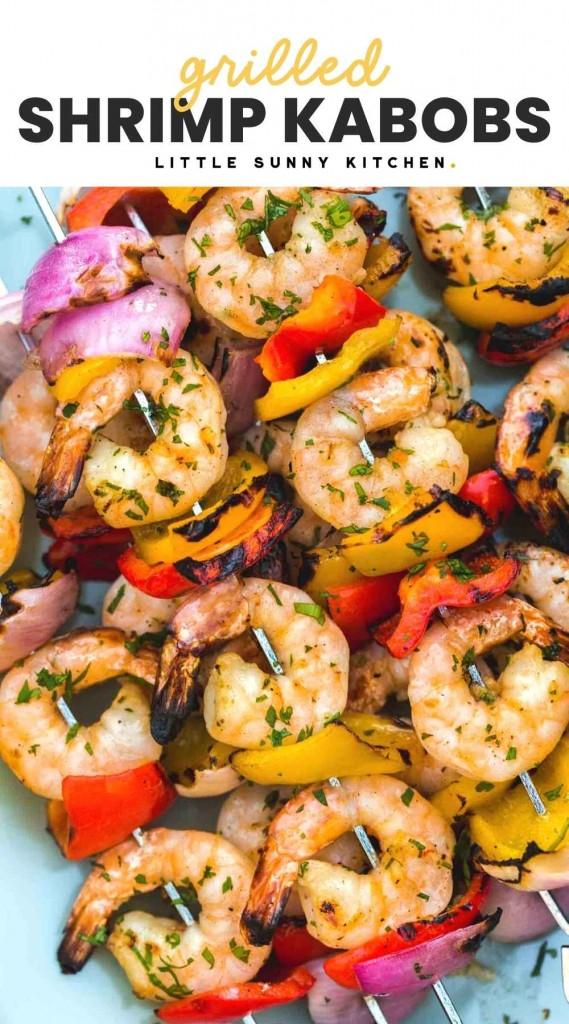 """Grilled shrimp kabobs served on a blue platter with overlay text """"Grilled shrimp kabobs"""""""
