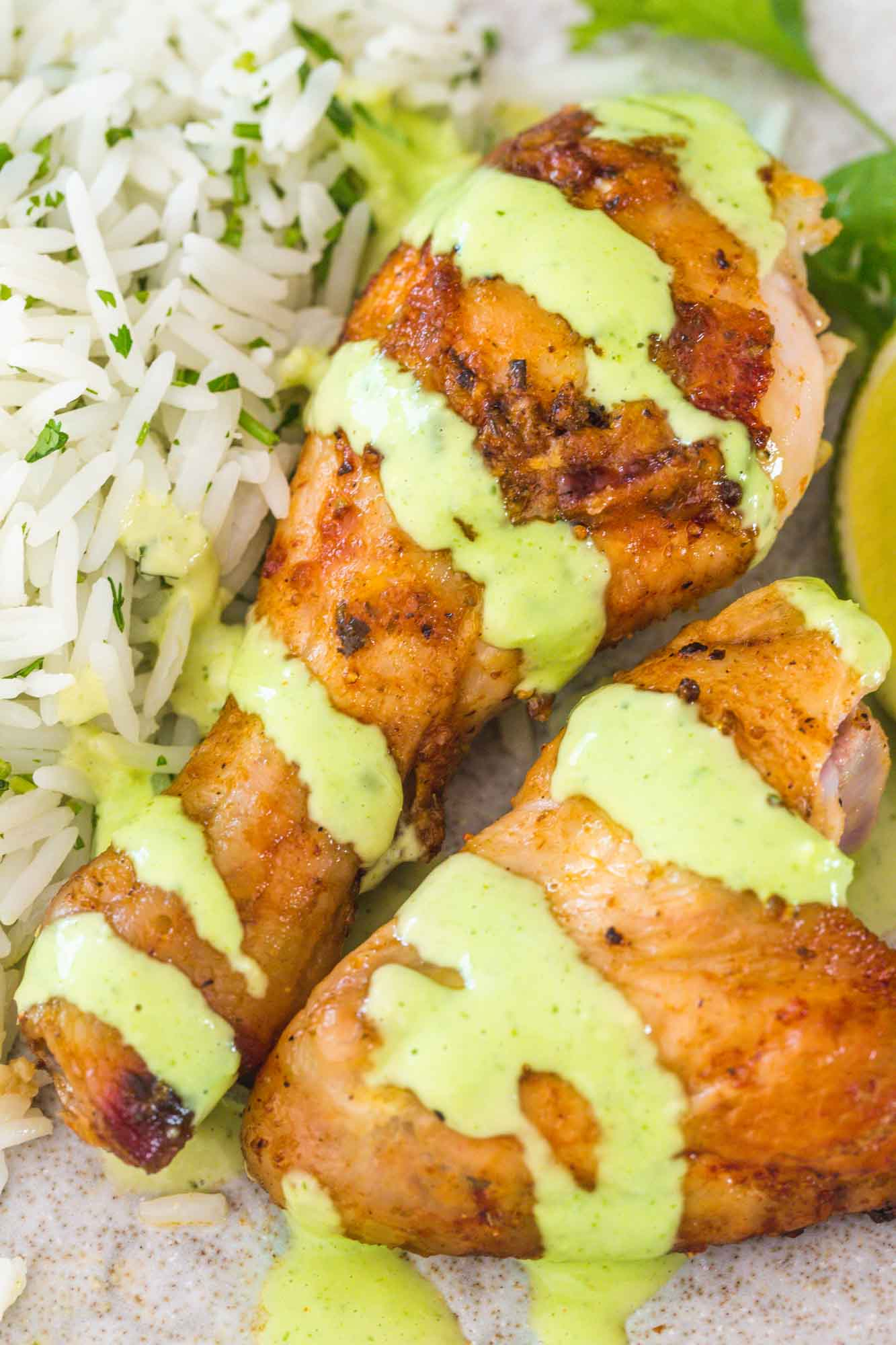 Peruvian chicken drumstick and wing with aji verde sauce, served over Mexican cilantro lime rice