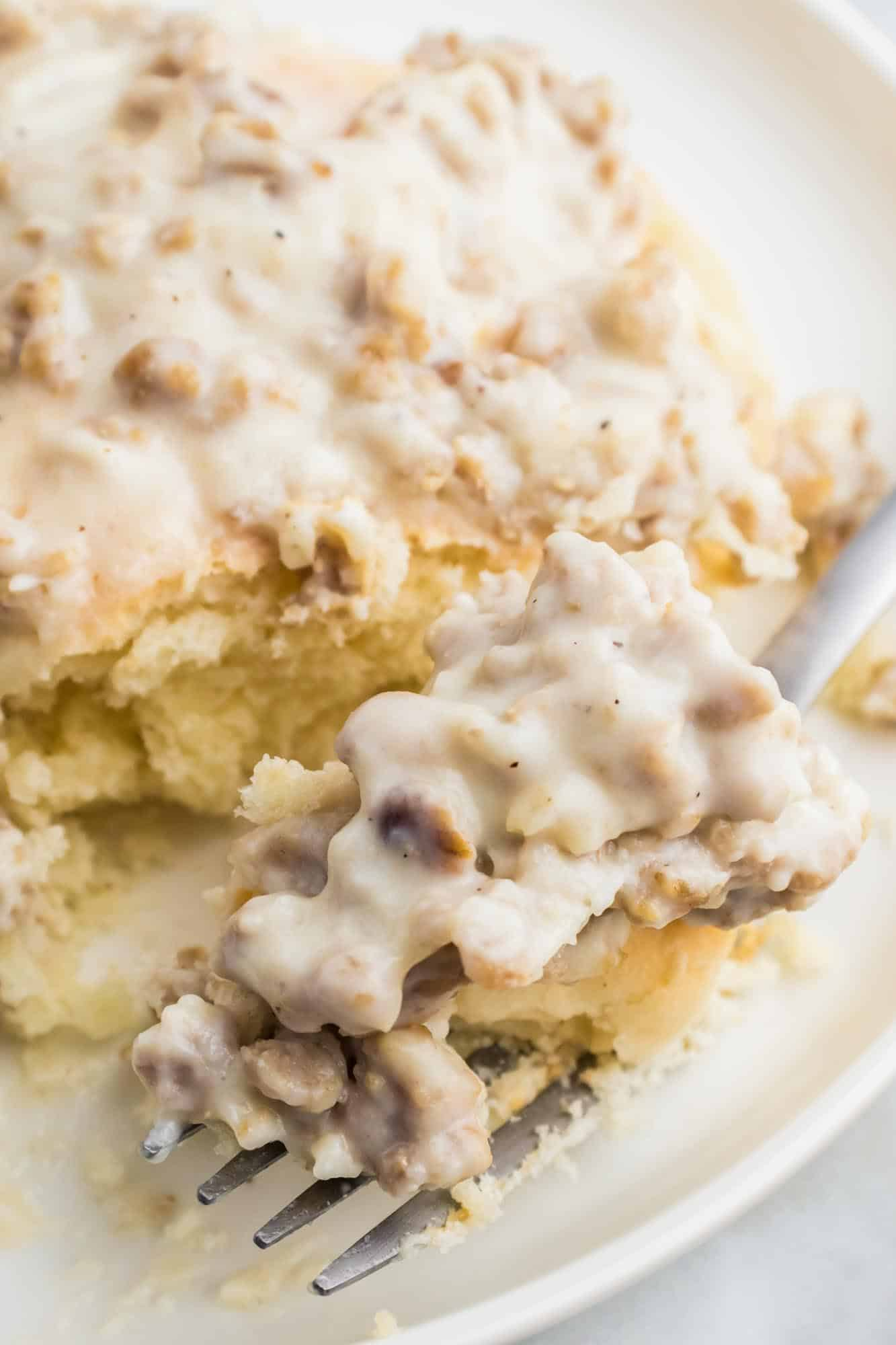 Sausage gravy on a biscuit and a fork to eat