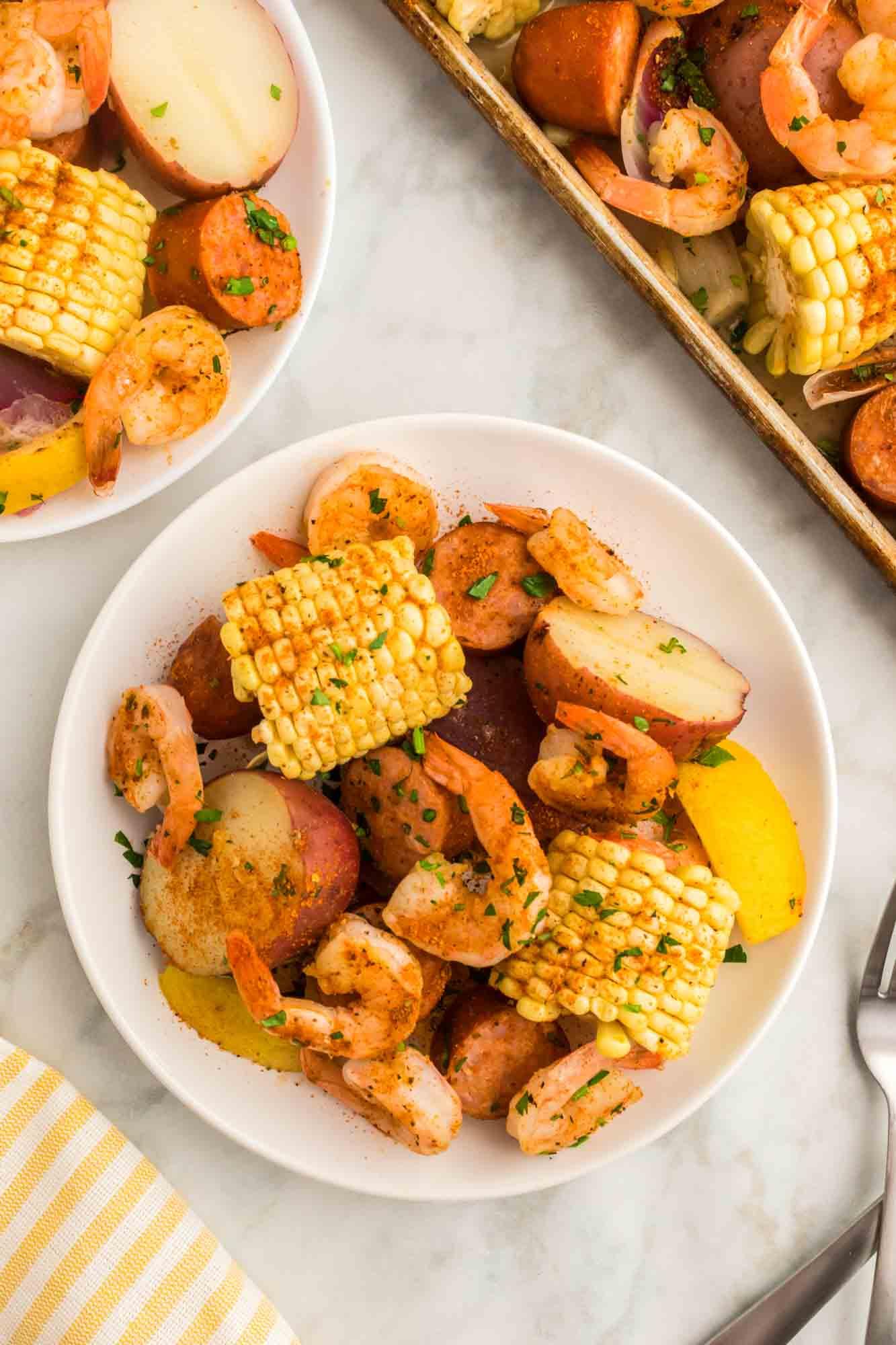 Shrimp boil served on white plates for individual servings