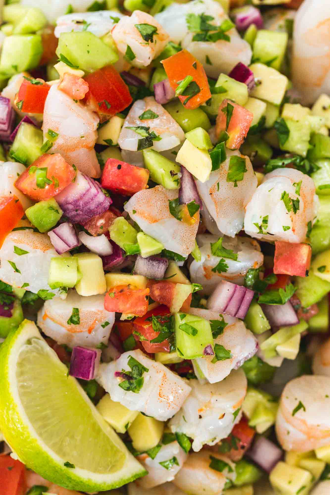 Close up shot of Shrimp ceviche with fresh lime wedges