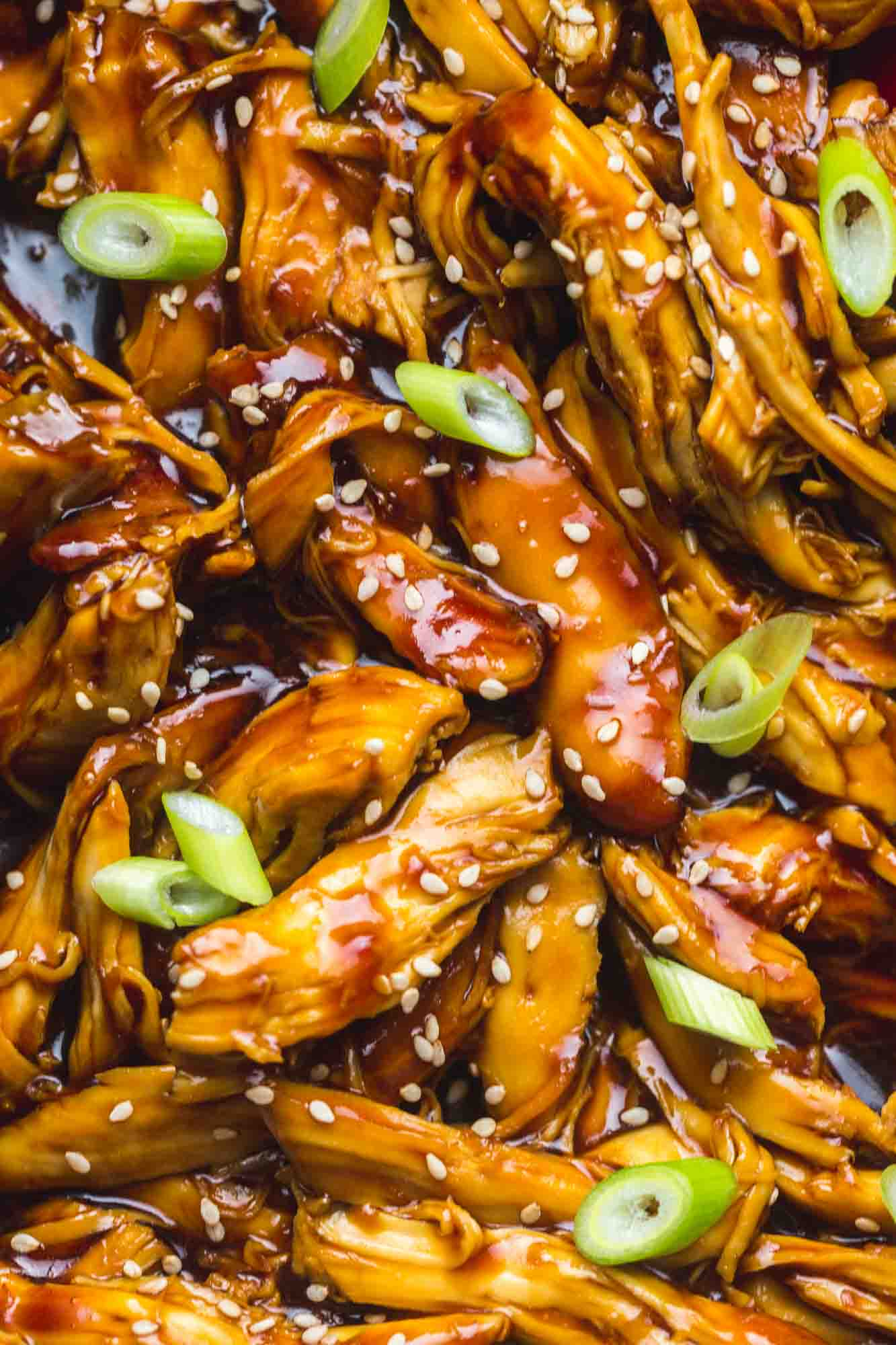 Close up of the teriyaki shredded chicken garnished with sesame seeds and sliced green onion