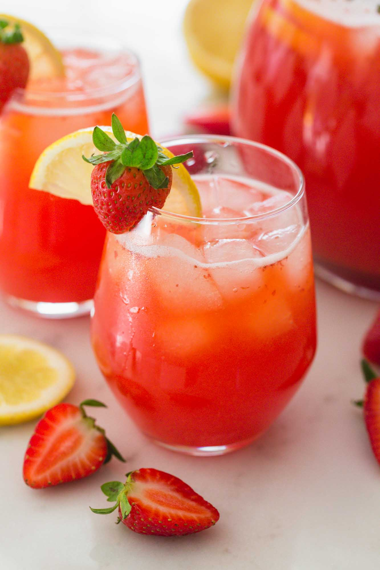 Chilled strawberry lemonade served with ice in a glass