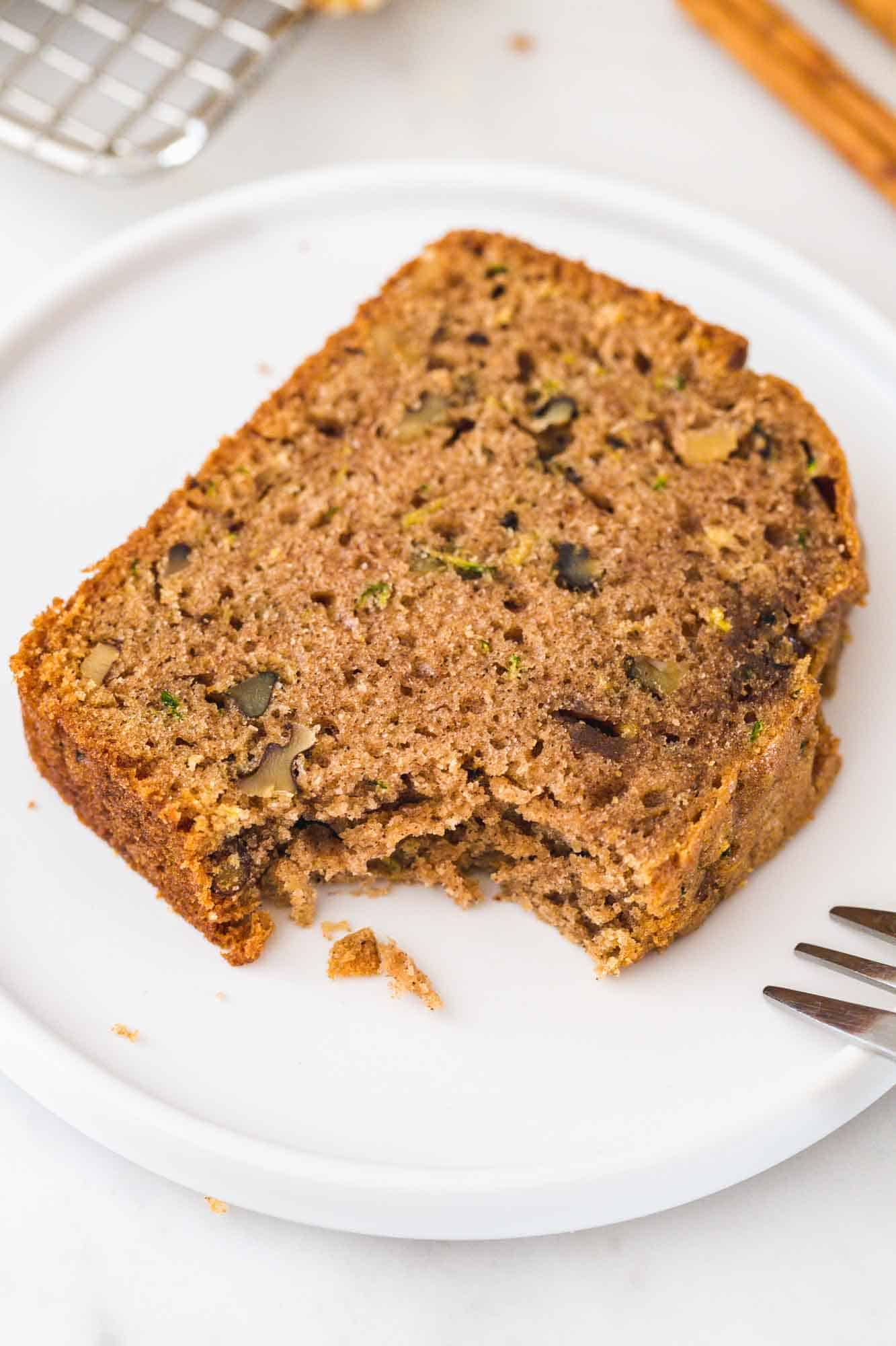 A slice of zucchini bread served on a white plate