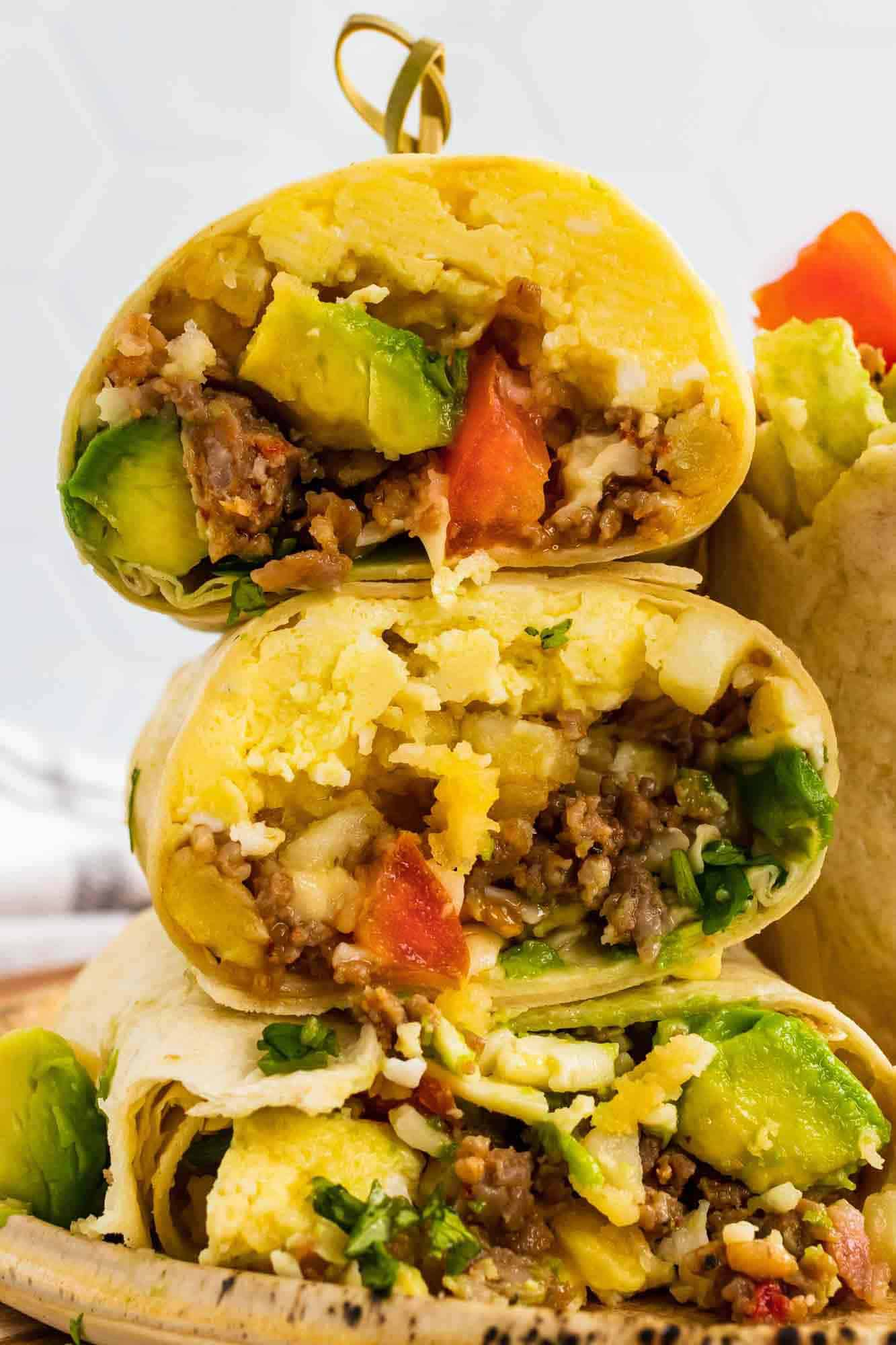 Breakfast burrito stacked on a plate