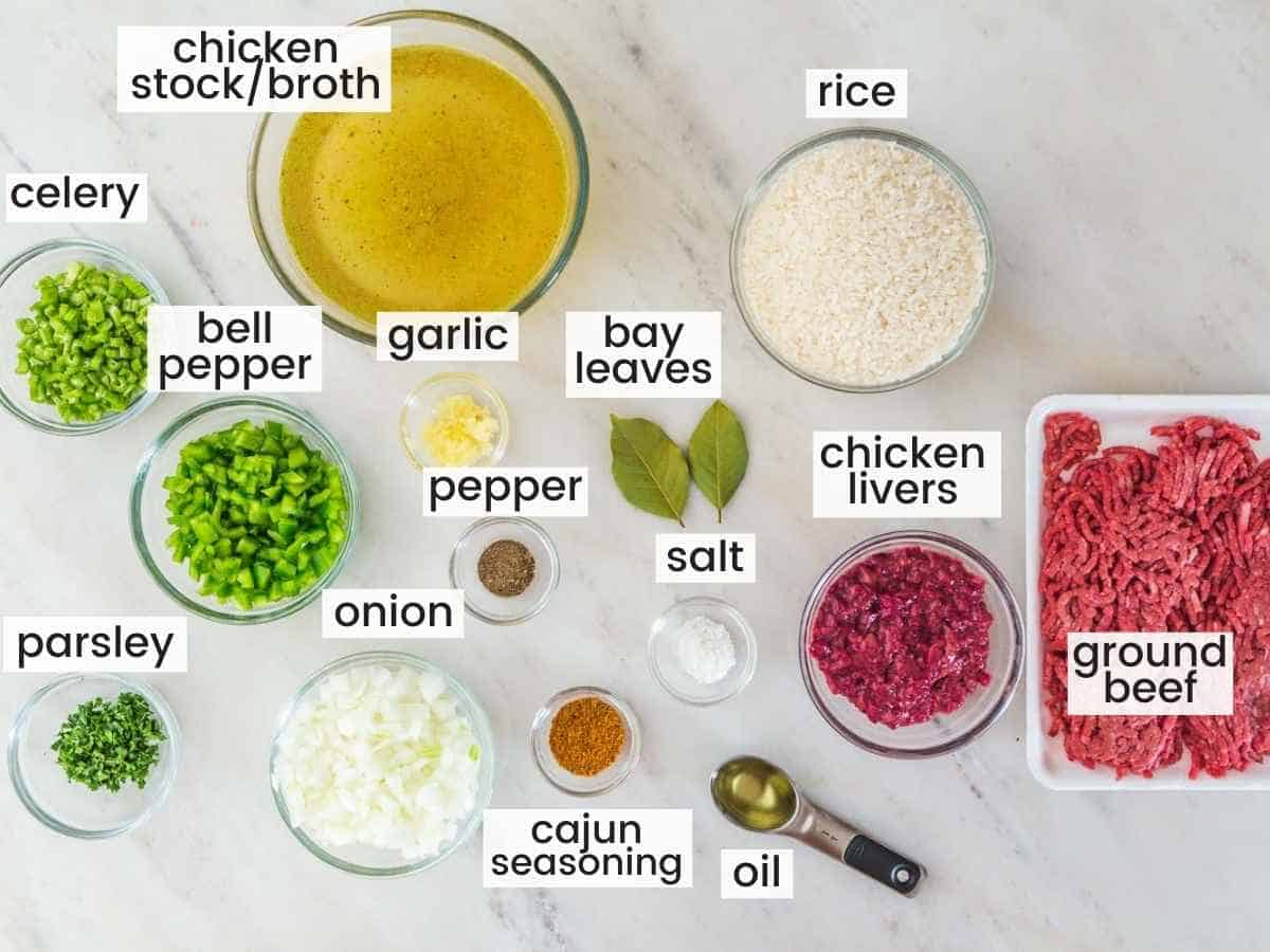 Dirty rice ingredients including chicken stock, rice, ground beef, onion, bell pepper, garlic, celeery, and seasonings.