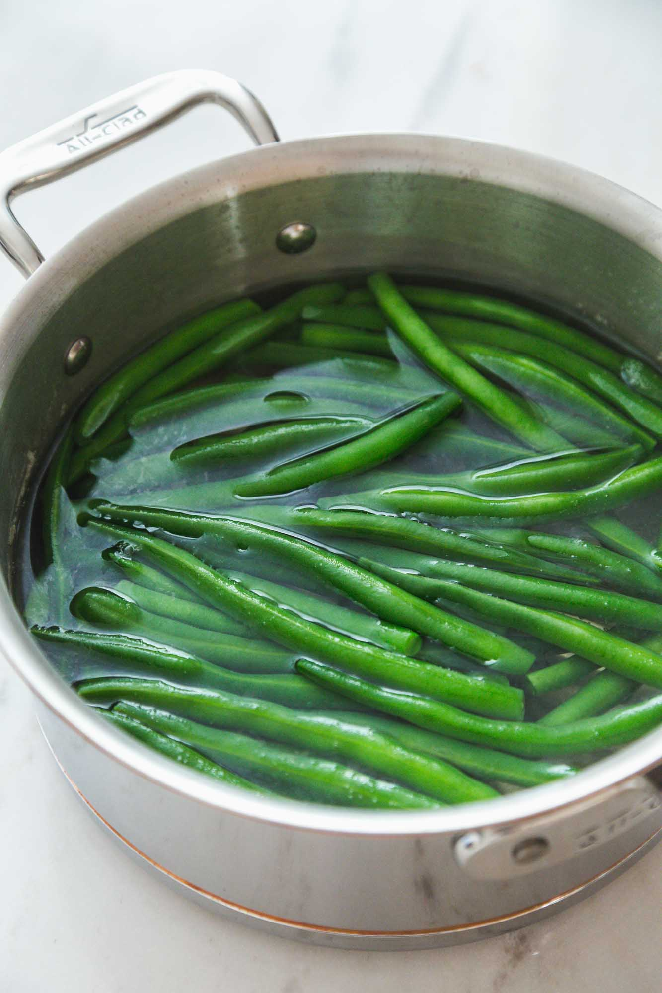 Green beans in a saucepan with water