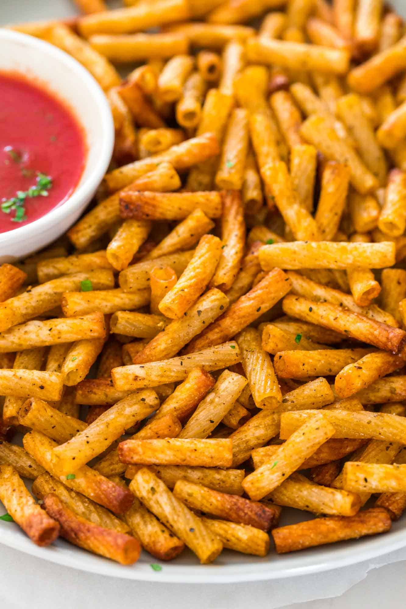 Close up shot of pasta chips on the plate with the dip