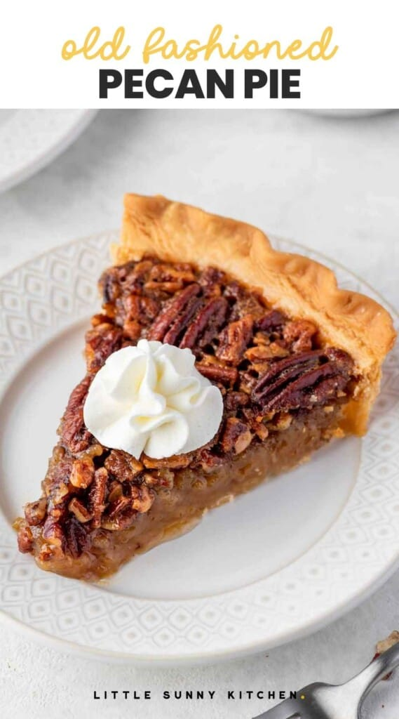 """A slice of pecan pie with whipped cream served on a white plate, with overlay text """"old fashioned pecan pie"""""""
