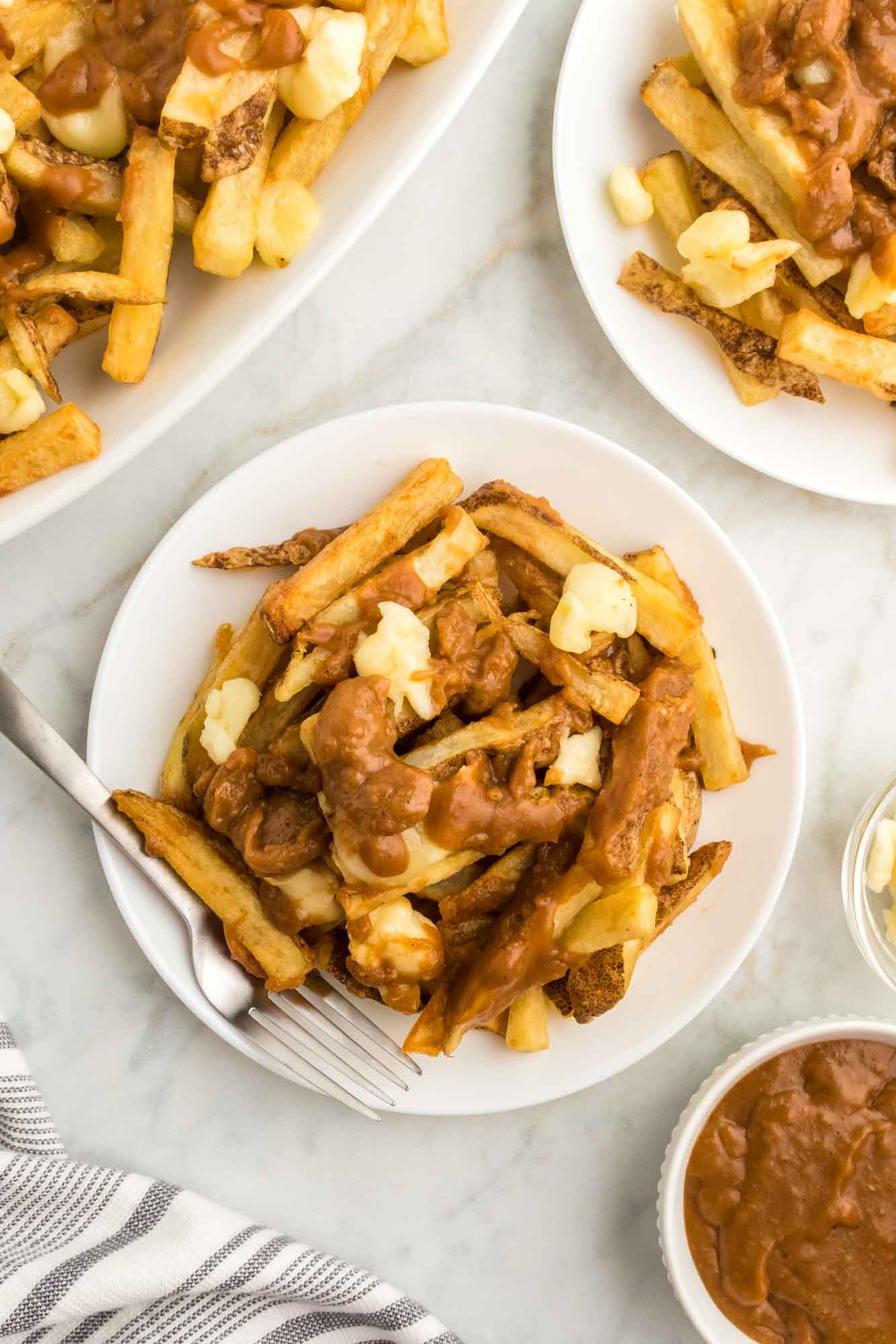 Poutine plated in single servings