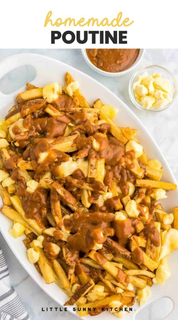 """Poutine fries with gravy and cheese served in a large white platter, and overlay text """"homemade poutine"""""""