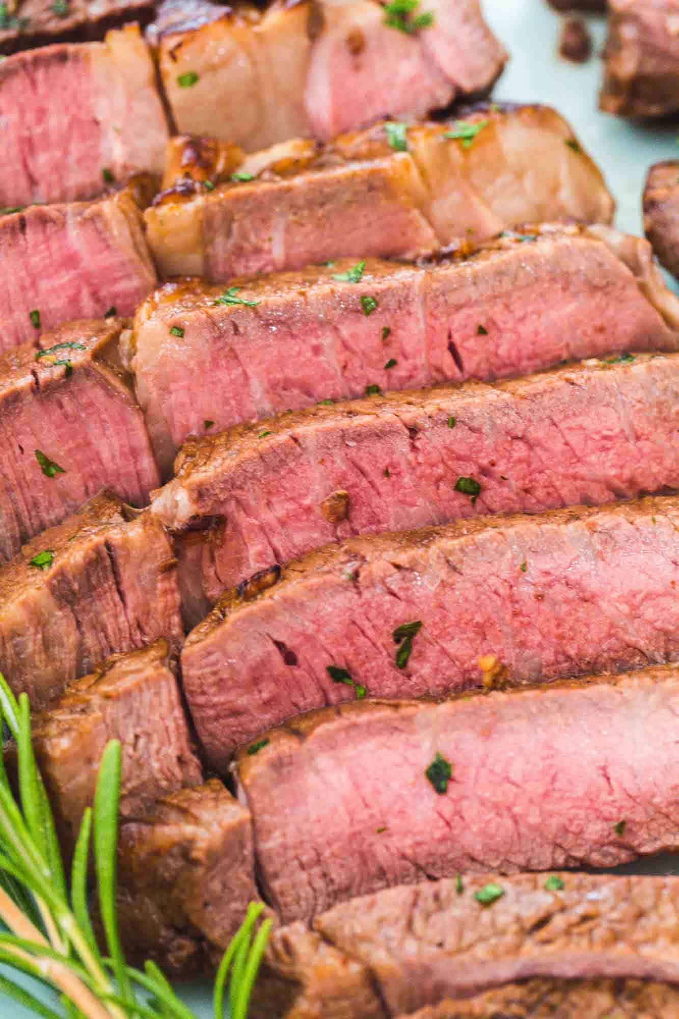 Sliced medium air fried steak on a plate