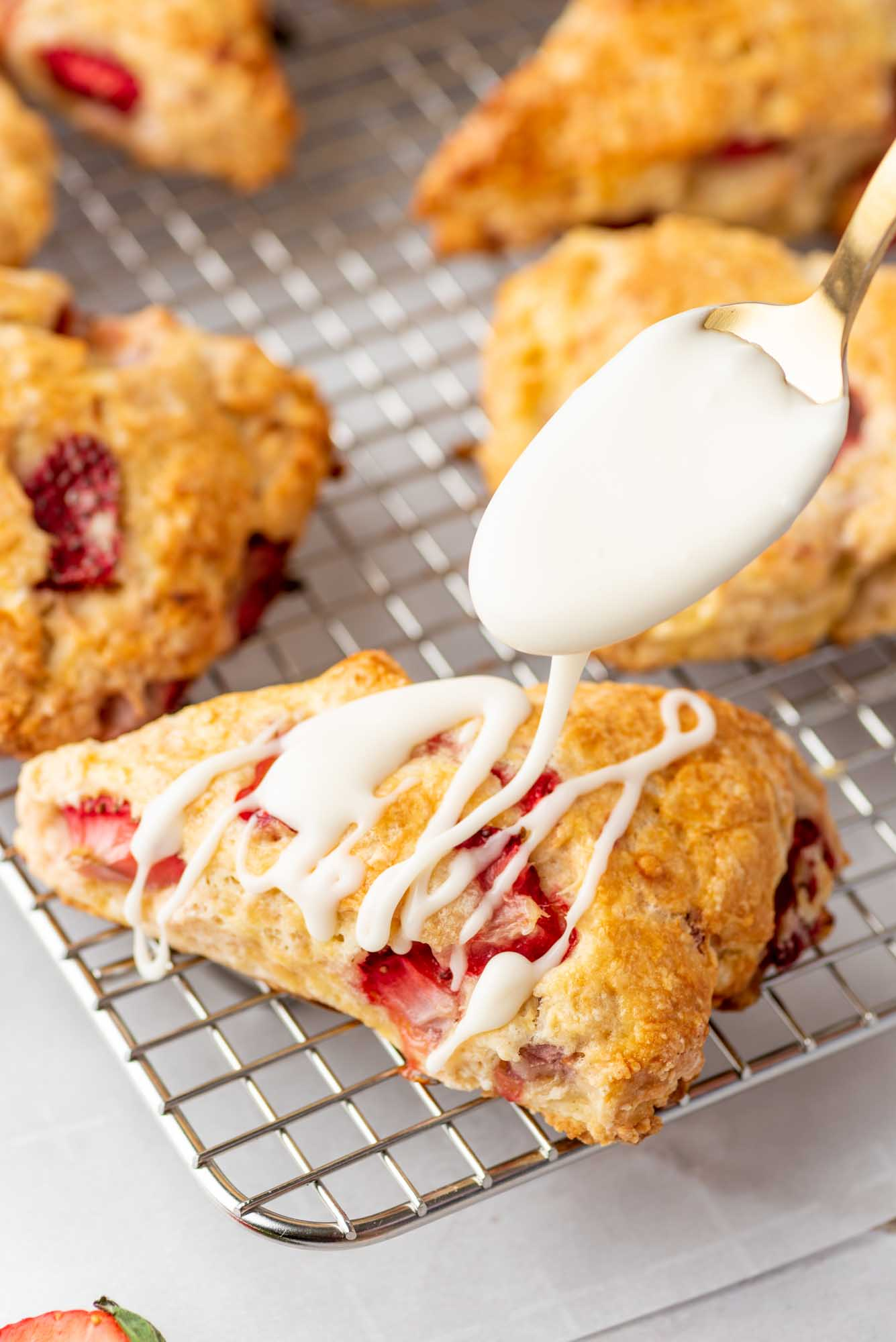 Drizzle glaze over the scones on a wire rack