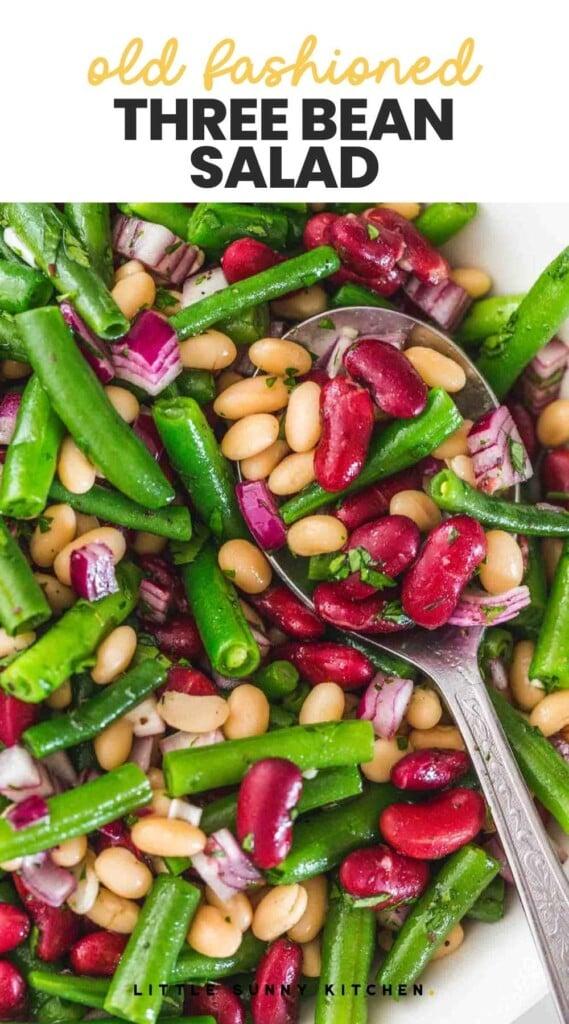 """ClosClose up shot of three bean salad and overlay text """"old fashioned three bean salad"""""""