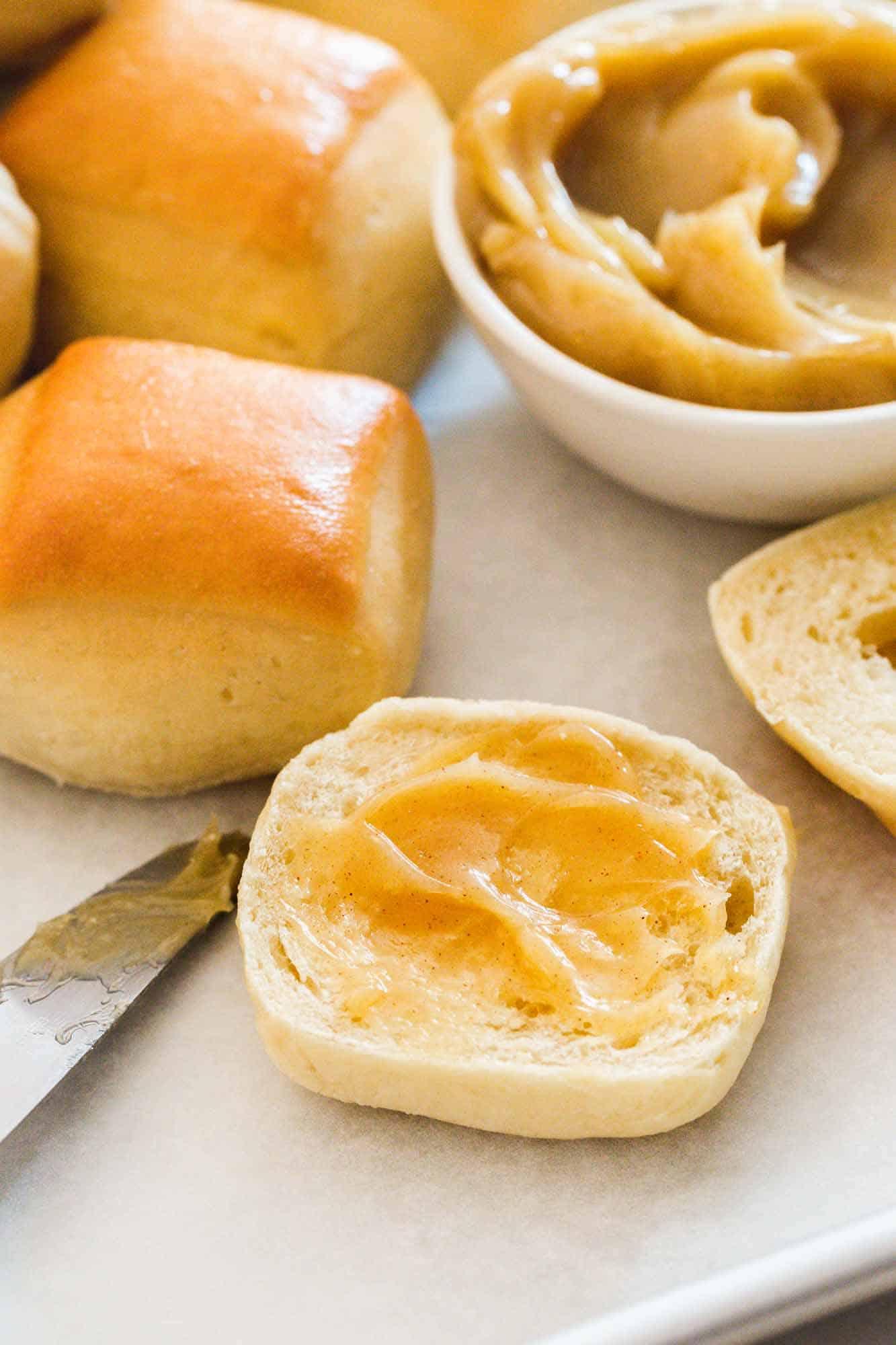 Fresh rolls with cinnamon honey butter spreaded