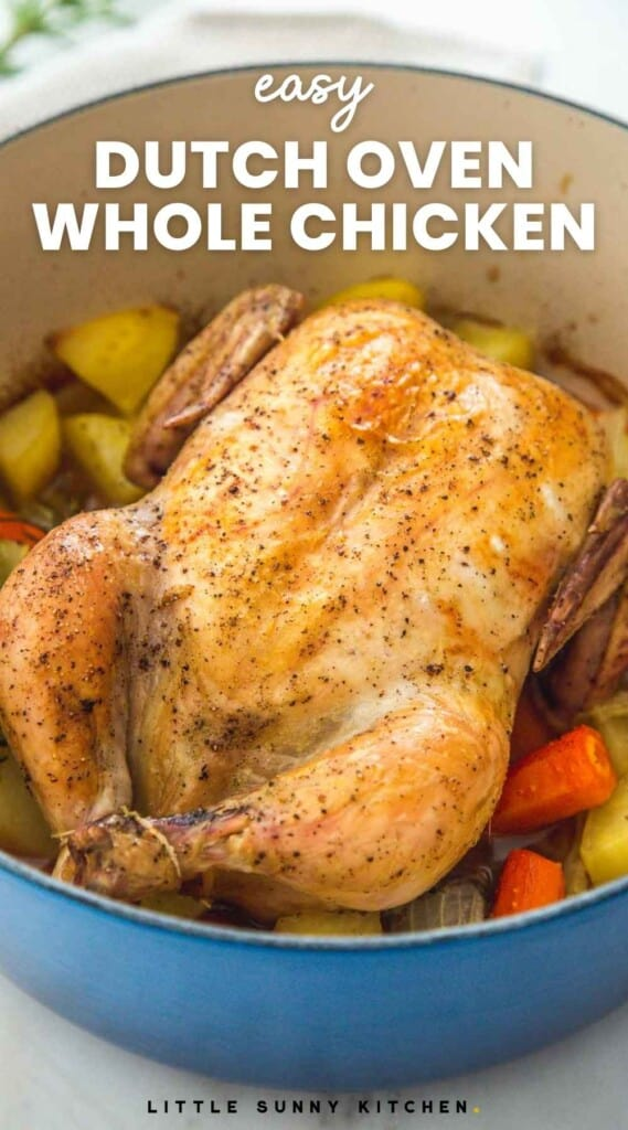 """Roast chicken in a blue dutch oven with vegetables and overlay text that reads """"easy dutch oven whole chicken"""""""