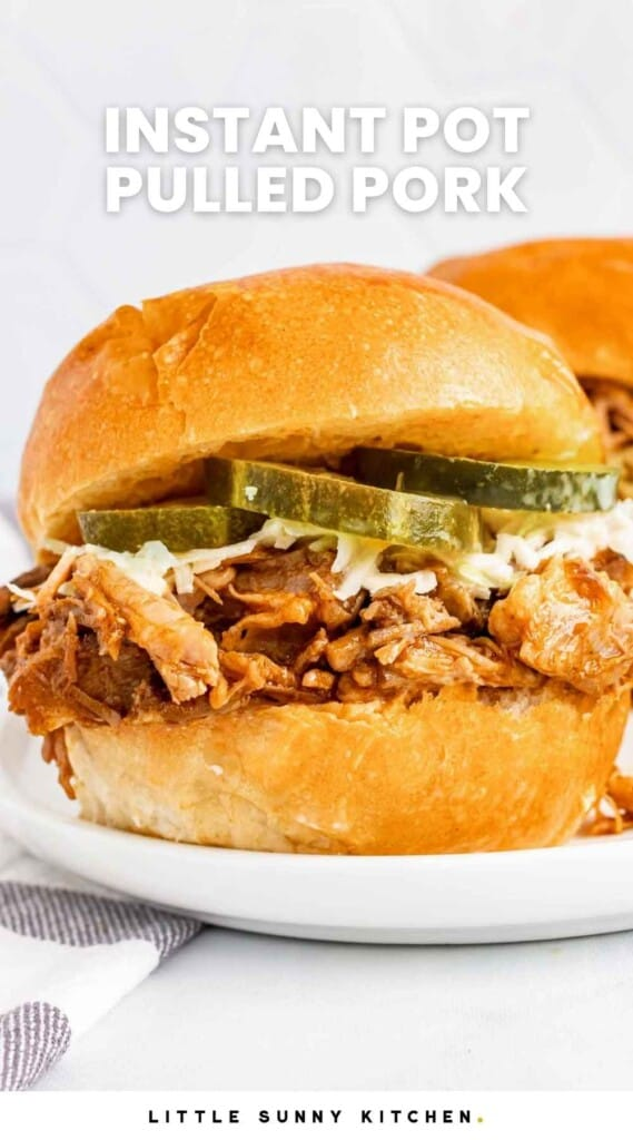 """Pulled pork served in a bun with slaw and pickles, and overlay text that reads """"Instant pot pulled pork"""""""