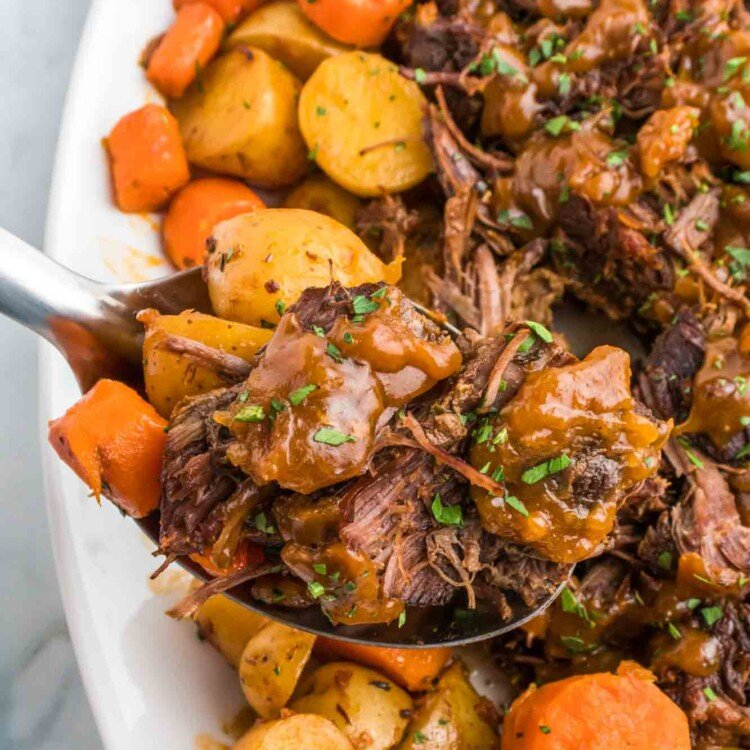 Serving pot roast with a serving spoon