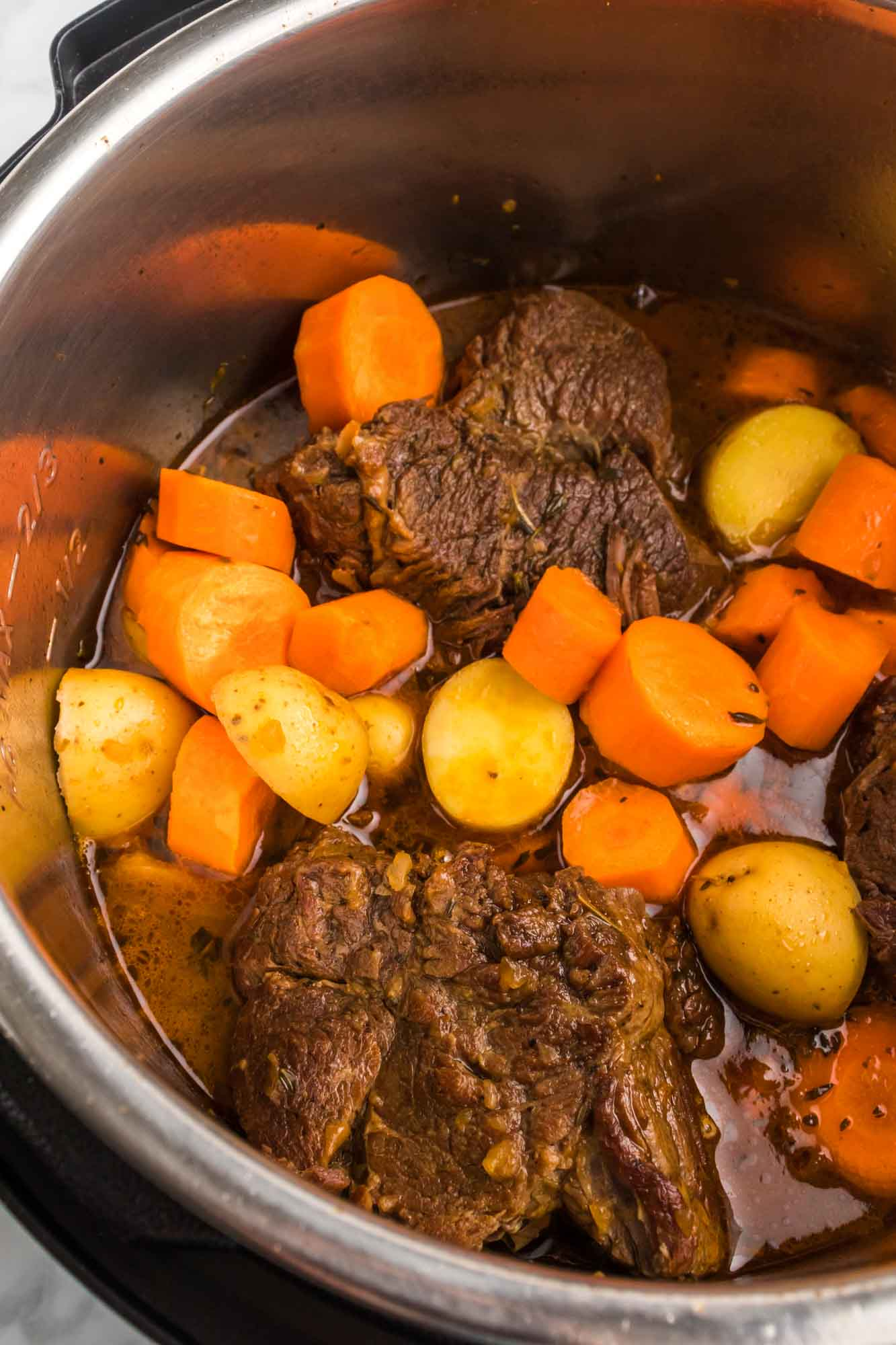 Cooked chuck roast in the instant pot with potatoes and carrots