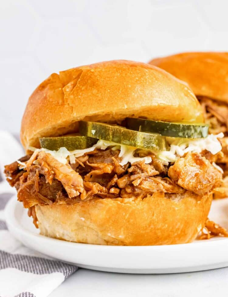 Pulled pork in a slider with slaw and pickles