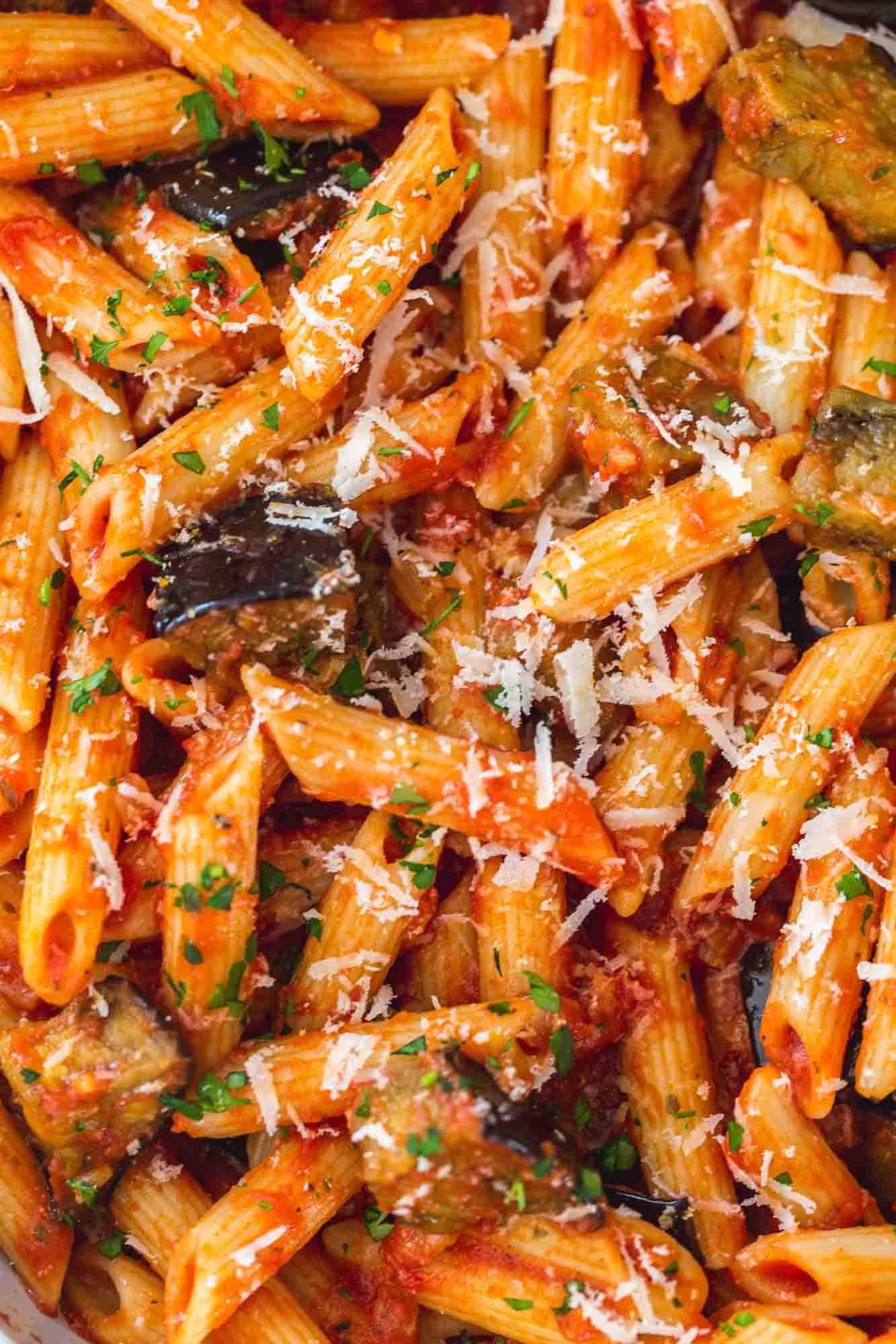 Close up shot of eggplant pasta with parmesan on top