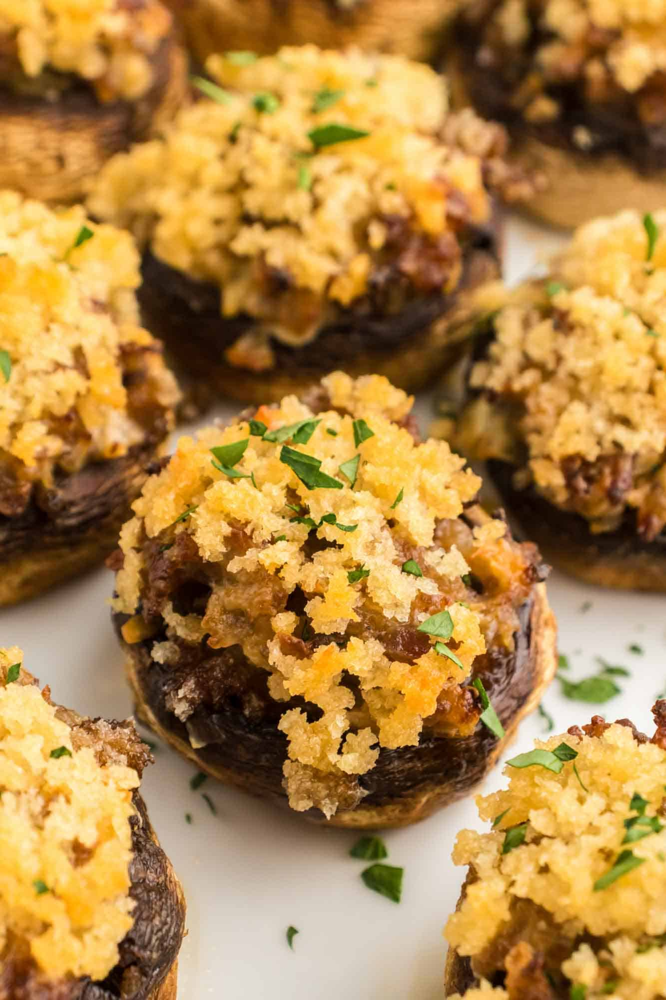 Sausage stuffed mushrooms served on a white plate