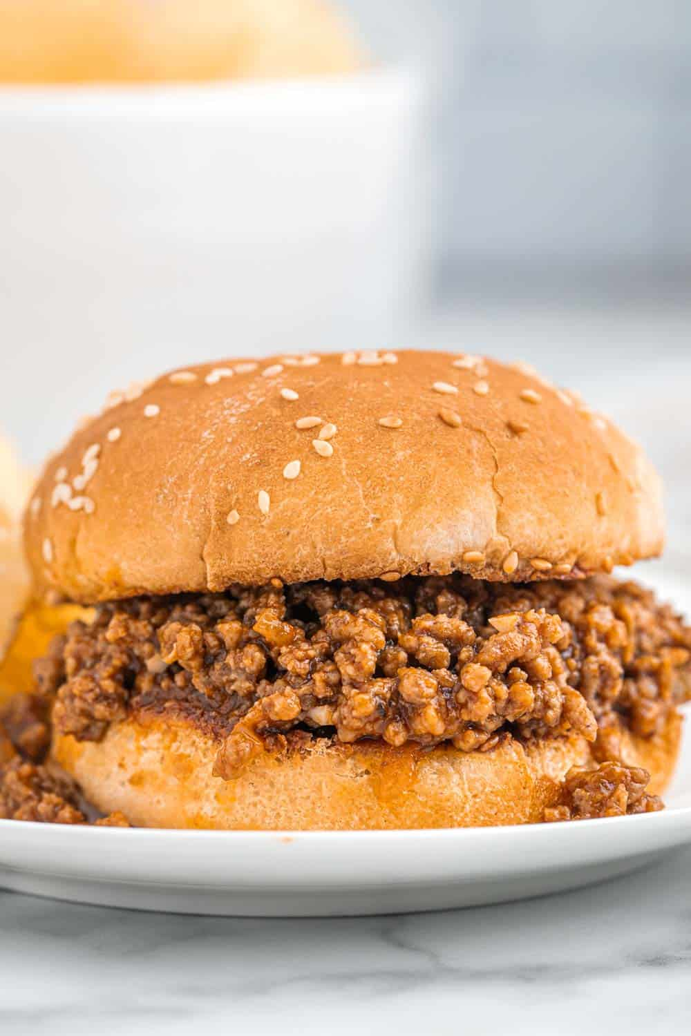 Sloppy joes roll on a white plate
