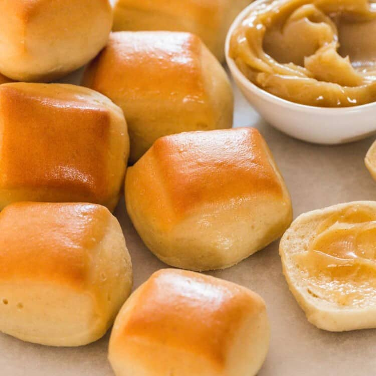 A few Texas roadhouse rolls served with cinnamon honey butter on the side