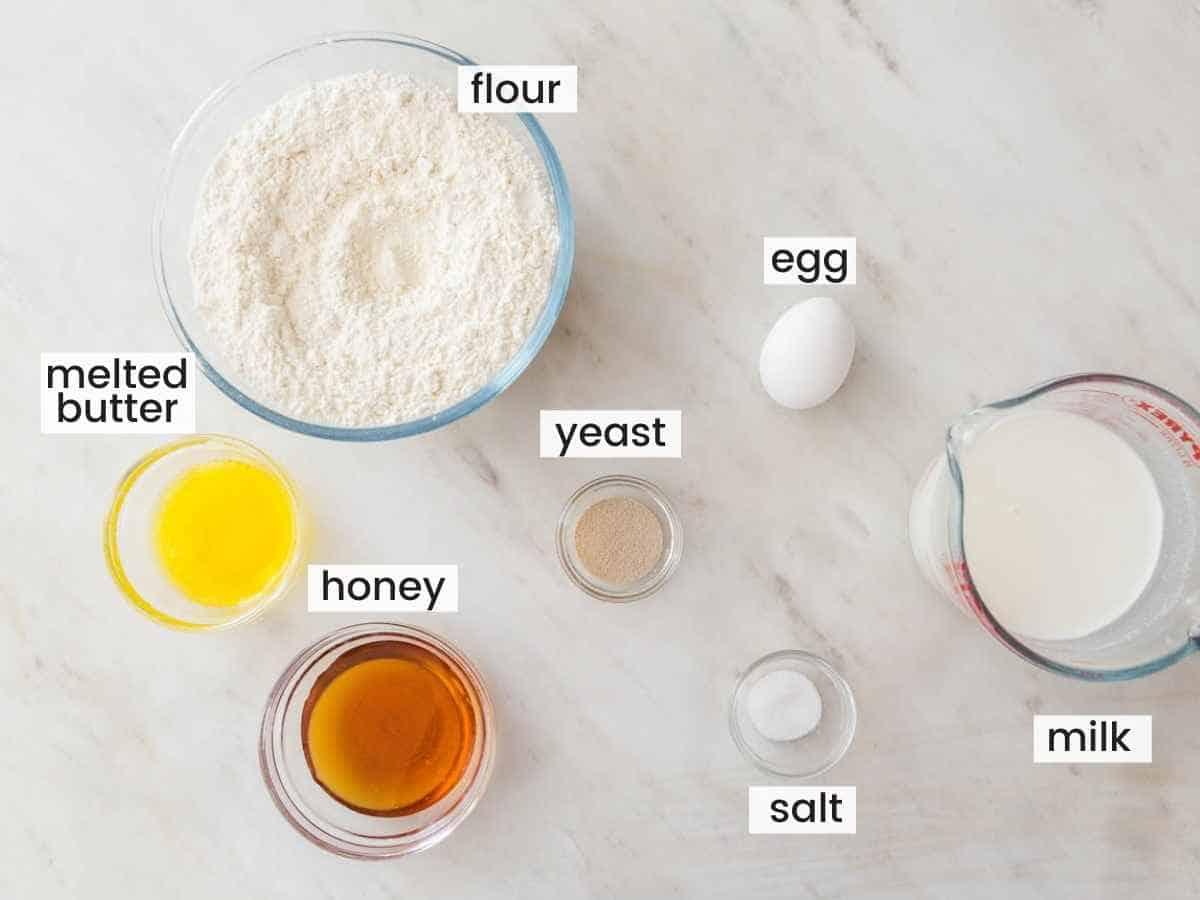 Texas Roadhouse Rolls Ingredients including flour, honey, egg, milk, yeast, butter, salt.