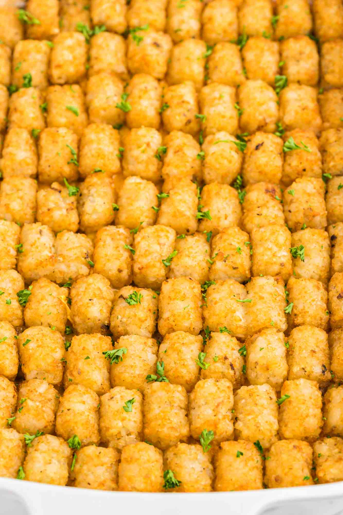 Overhead shot of a tater tot casserole featuring the arranged tater tots