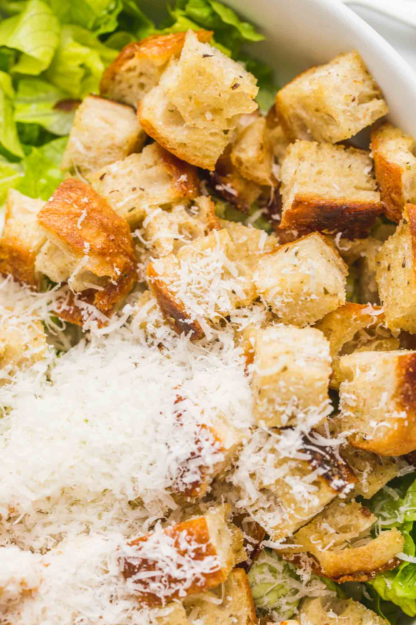 Croutons in a salad with parmesan and romaine