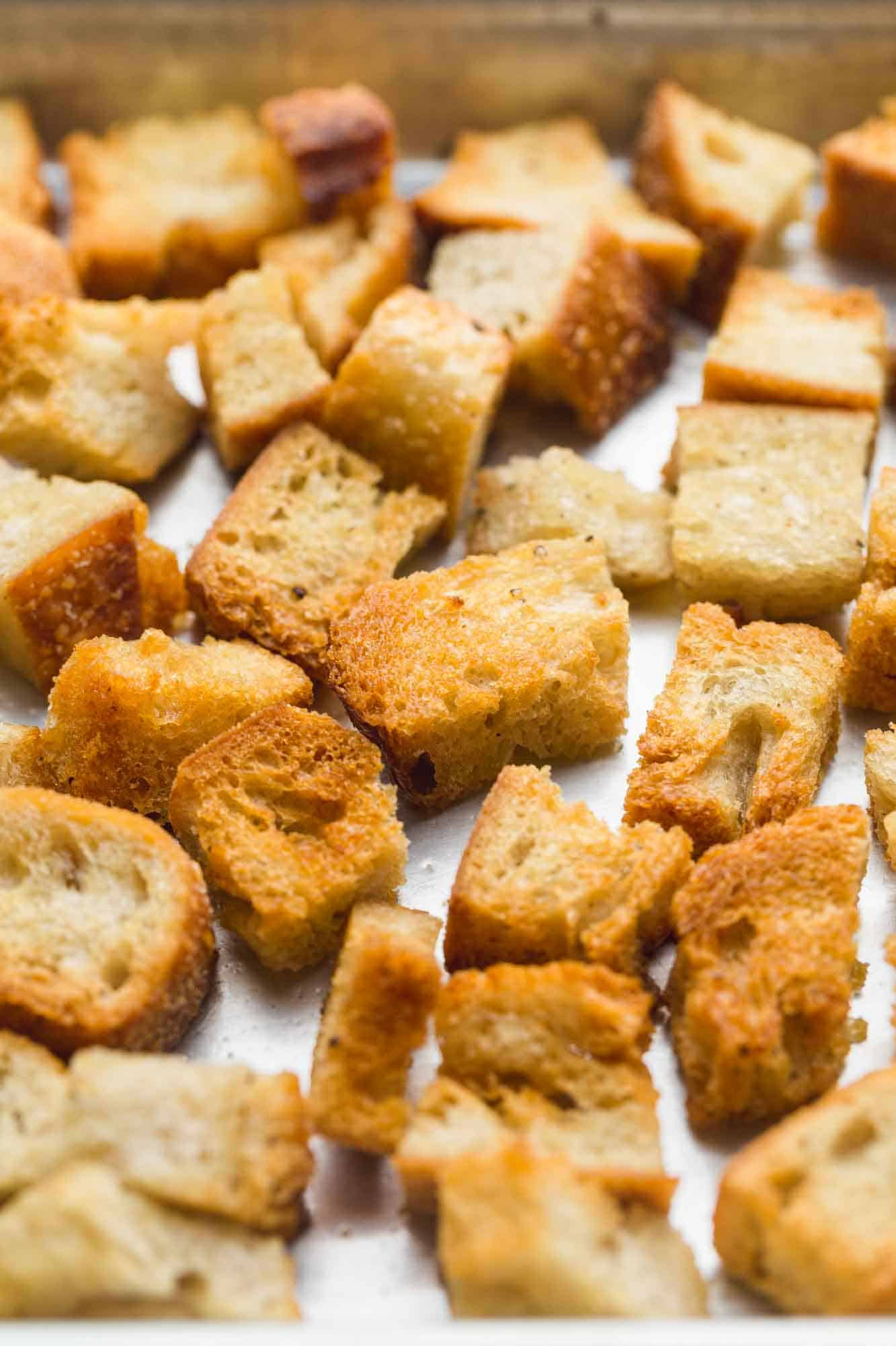 Close up shot of homemade toasted croutons on a baking sheet