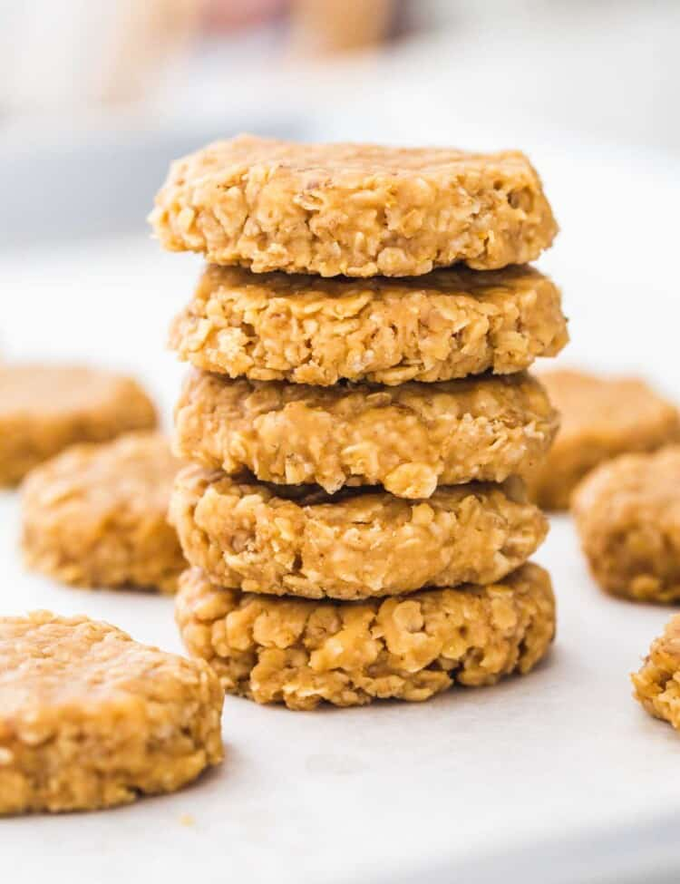 A stack of no bake peanut butter cookies on a white board