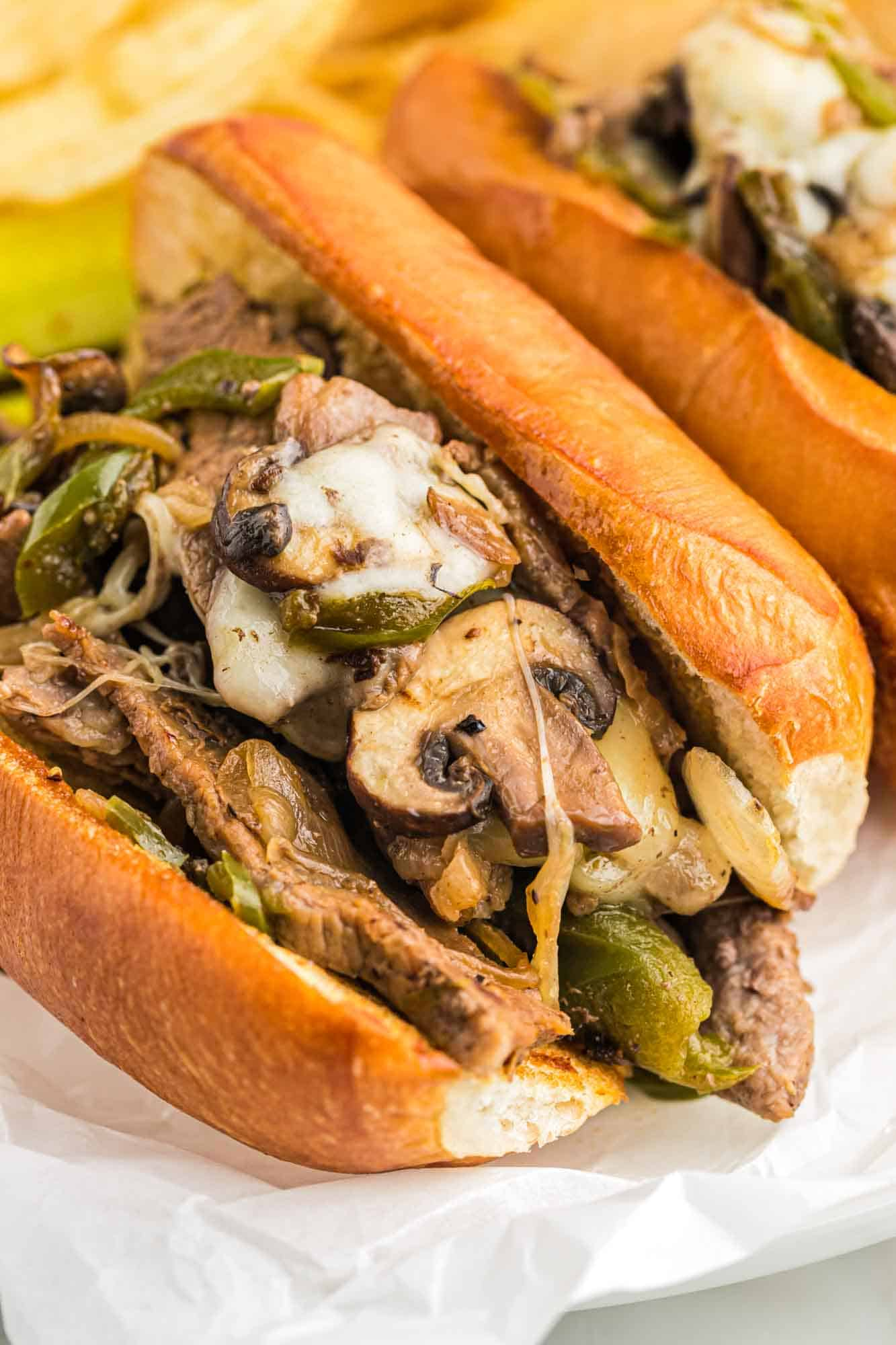 Philly cheesesteak sandwiches served on a plate