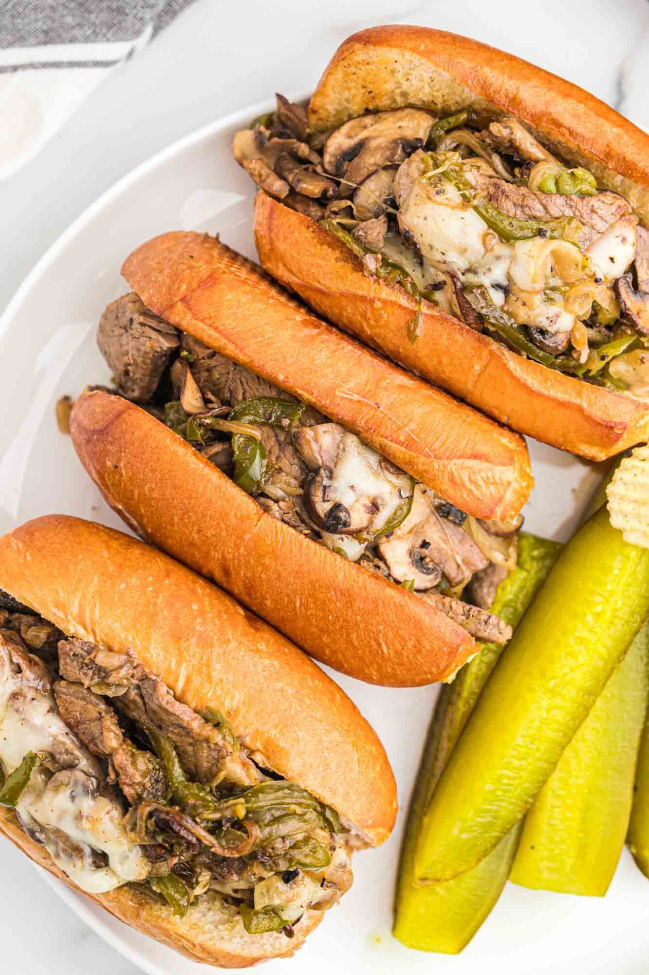 Overhead shot of philly cheesteak sandwiches