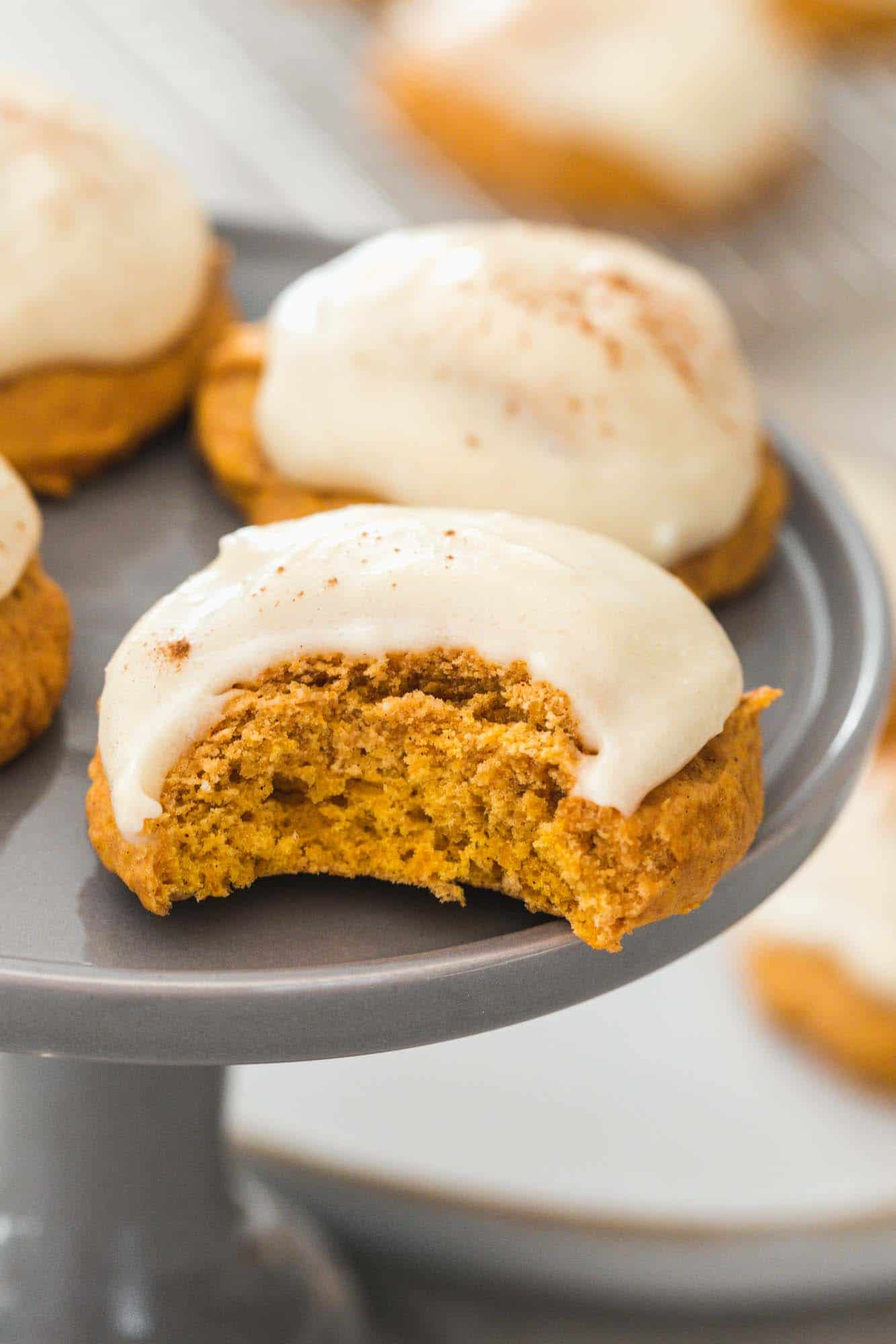 A bite shot of the pumpkin cookie frosted with cream cheese frosting